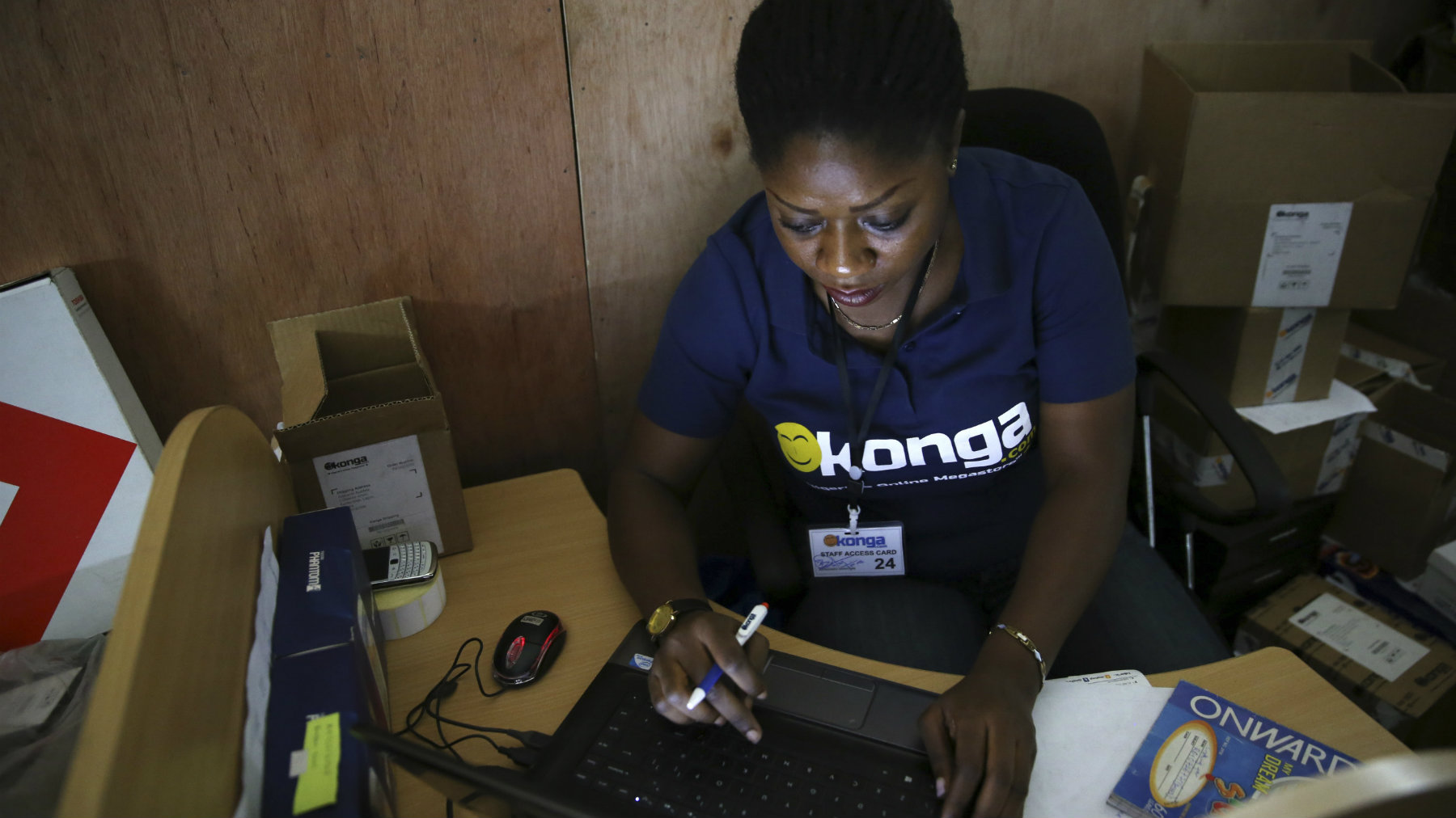 A staff inputs data into a computer at the warehouse of Konga online shopping company in Ilupeju district in Nigeria's commercial capital Lagos.