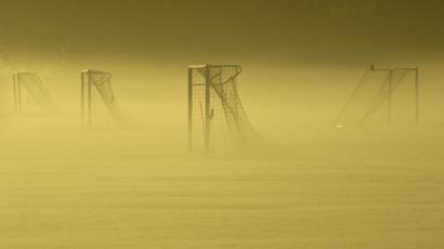 Soccer goal posts are seen in the autumn mist at Dukes Meadows in Chiswick, west London