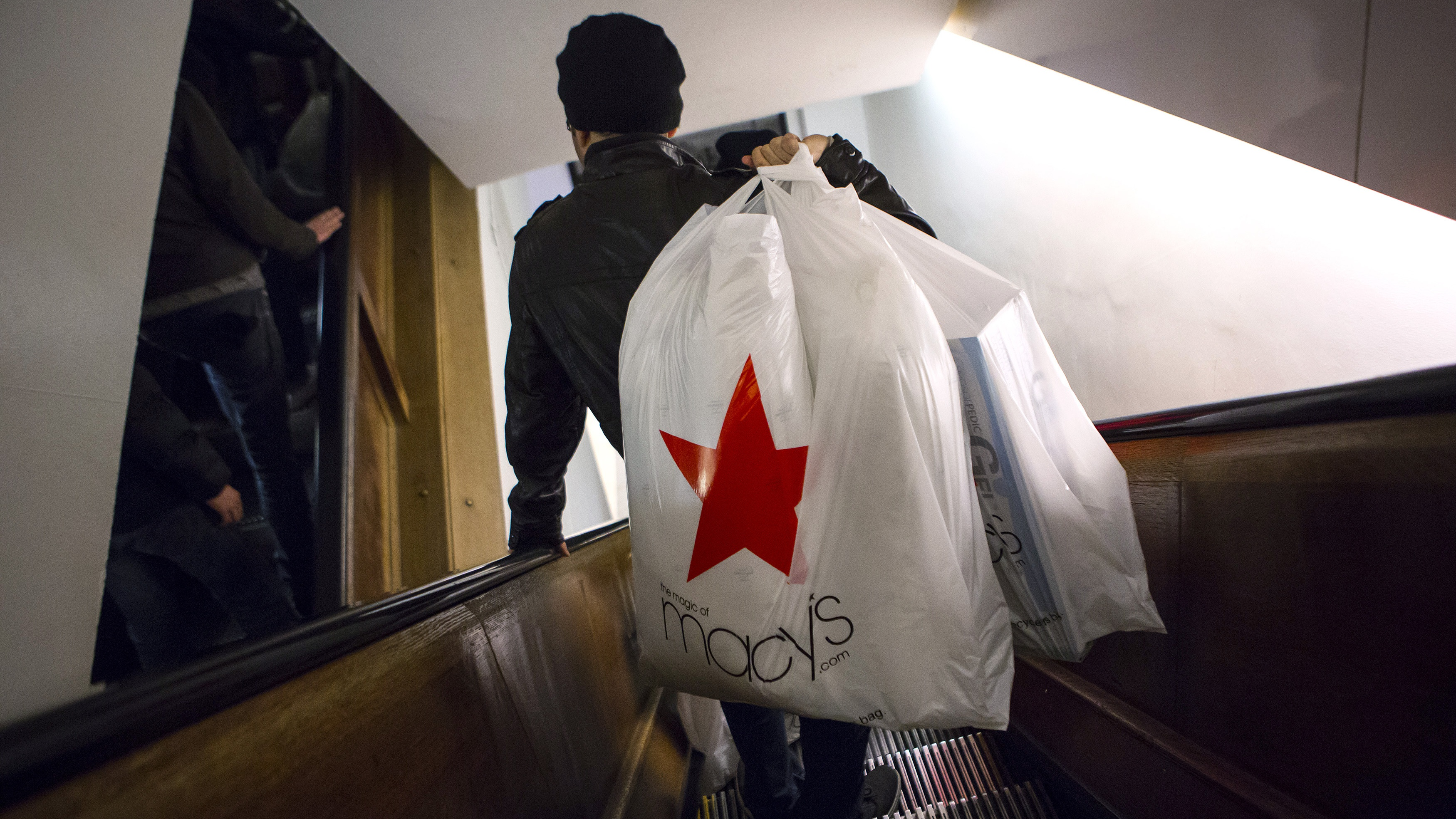 Shoppers ride the escalator at Macy's Herald Square in New York in this November 28, 2013