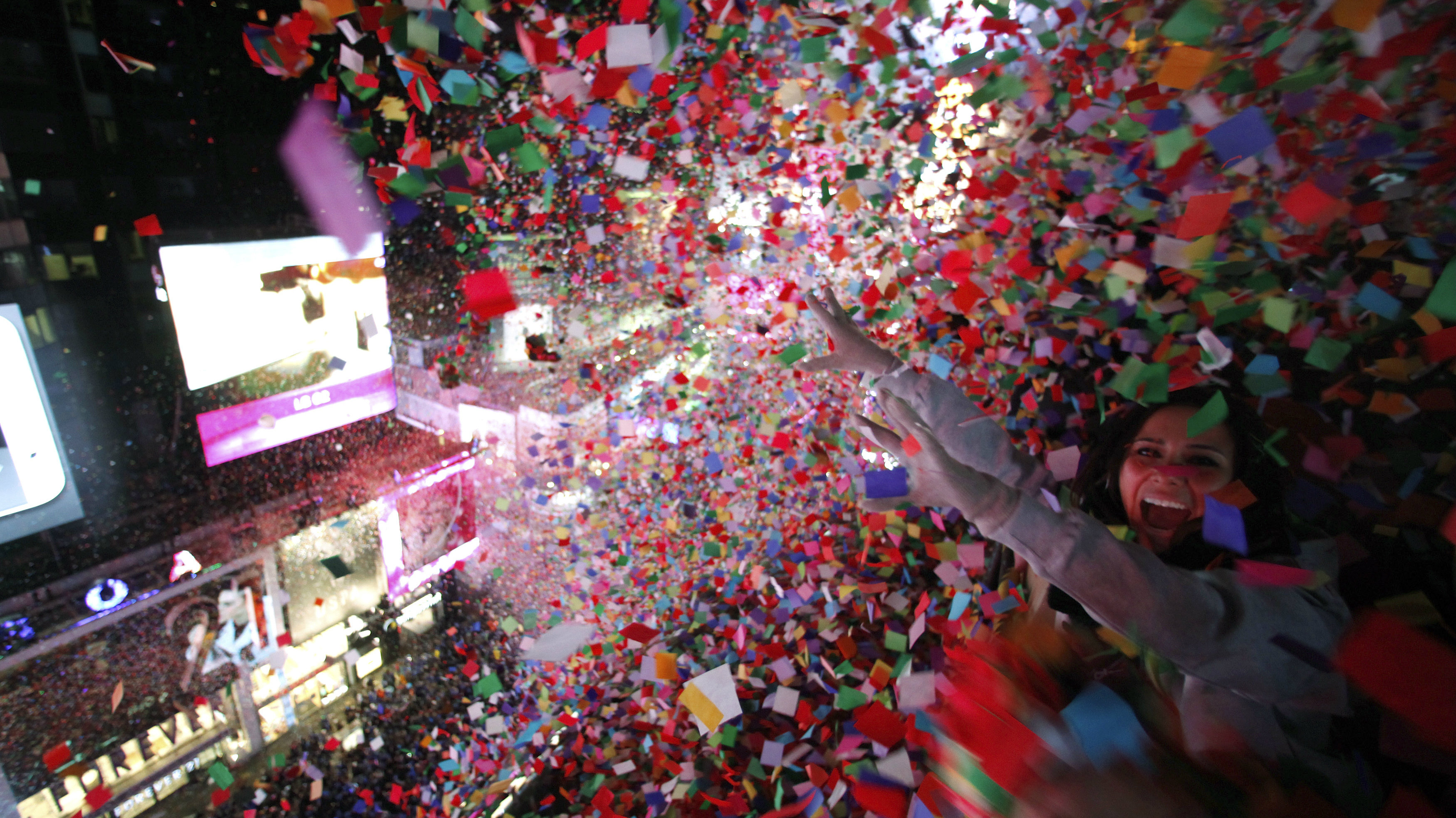 Confetti is dropped on revelers at midnight during New Year's Eve celebrations in Times Square in New York January 1, 2014.