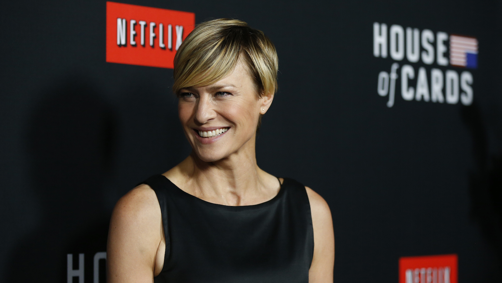 """Cast member Robin Wright poses at the premiere for the second season of the television series """"House of Cards"""" at the Directors Guild of America in Los Angeles, California February 13, 2014. Season 2 premieres on Netflix on February 14.   REUTERS/Mario Anzuoni  (UNITED STATES - Tags: ENTERTAINMENT) - RTX18SII"""