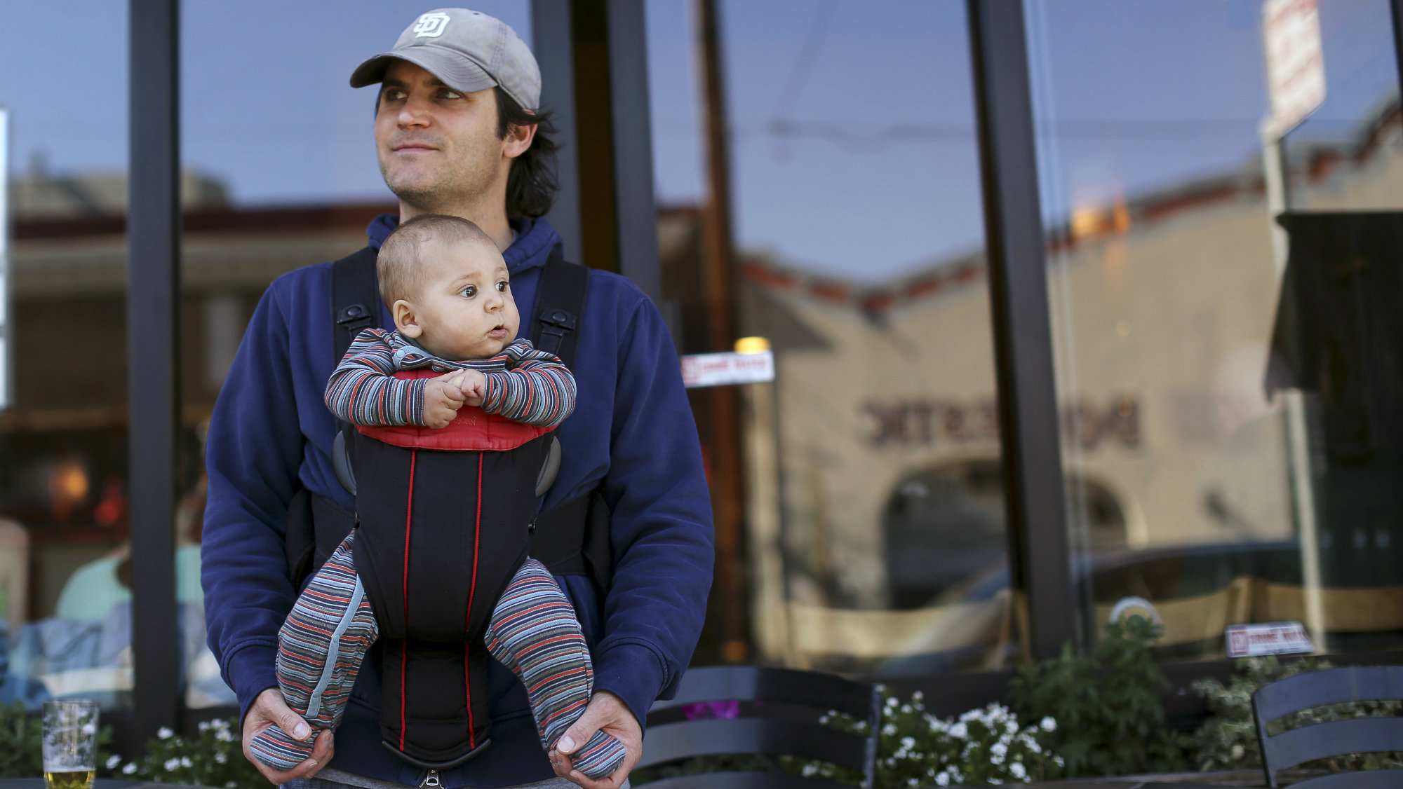 Steve Caniglia holds his six-month-old son, Boden, in San Francisco