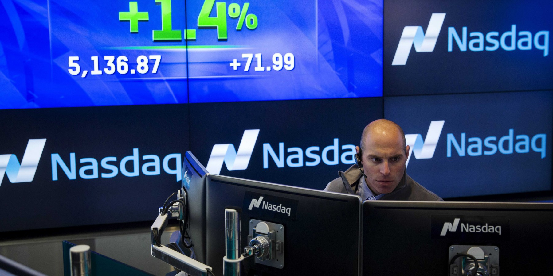 A trader works at his desk at the Nasdaq MarketSite in New York June 18, 2015. The Nasdaq composite index rose to a new intraday record of 5,143.32 on Thursday, 15 years after the dot-com bubble sent the index to its previous peak on March 10, 2000 to 5,132.52. REUTERS/Lucas Jackson TPX IMAGES OF THE DAY      - RTX1H5T3