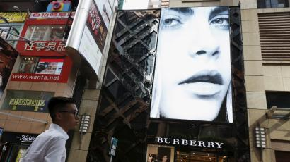 A model is seen on the screen of a Burberry store at Causeway Bay shopping district in Hong Kong, China, July 16, 2015.