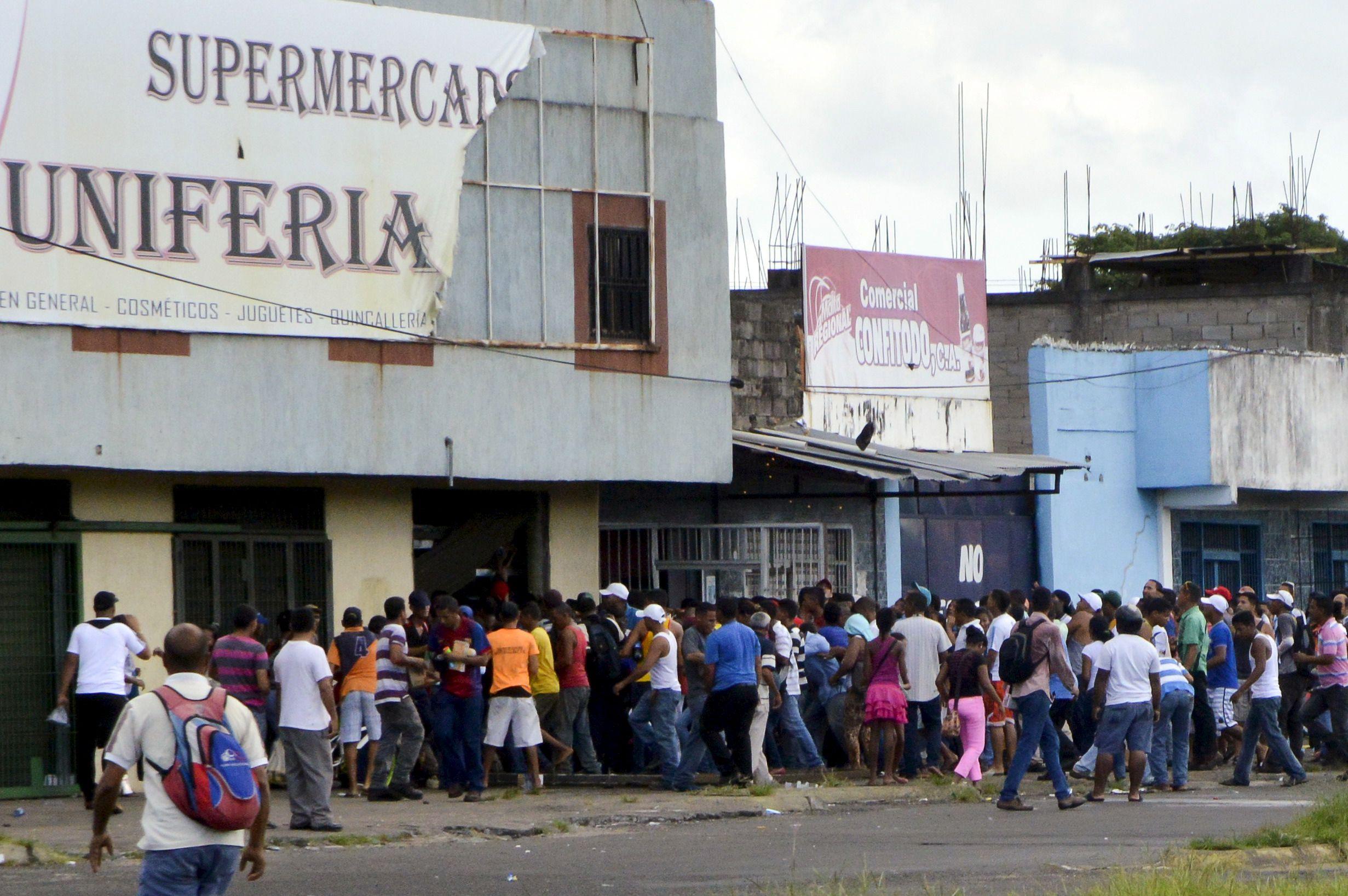 People loot a supermarket in San Felix in the state of Bolivar, Venezuela