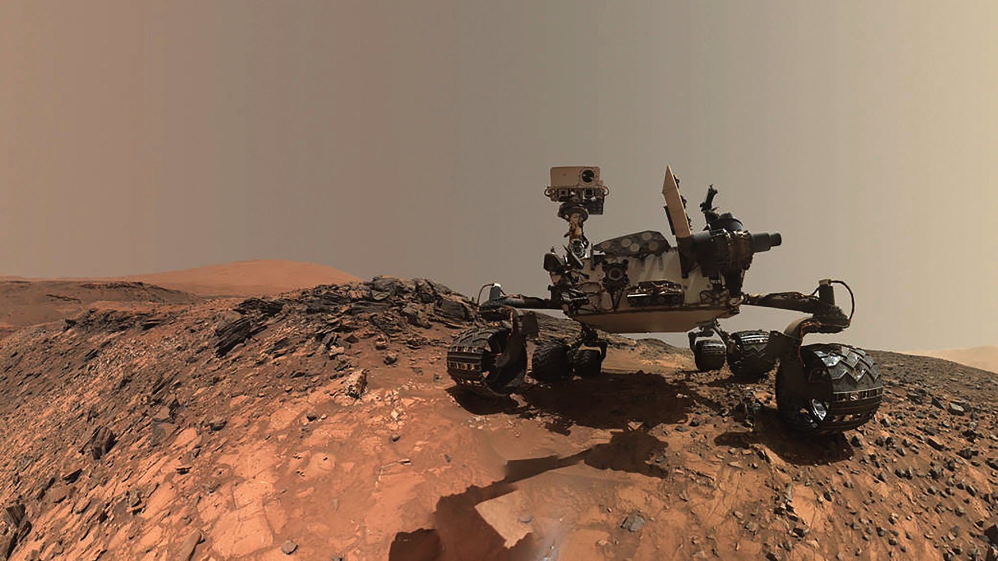 NASA's Curiosity Mars rover is seen at the site from which it reached down to drill into a rock target called 'Buckskin' on lower Mount Sharp in this low-angle self-portrait taken August 5, 2015 and released August 19, 2015. The selfie combines several component images taken by Curiosity's Mars Hand Lens Imager (MAHLI) during the 1,065th Martian day, or sol, of the rover's work on Mars, according to a NASA news release.  REUTERS/NASA/JPL-Caltech/MSSS/Handout  THIS IMAGE HAS BEEN SUPPLIED BY A THIRD PARTY. IT IS DISTRIBUTED, EXACTLY AS RECEIVED BY REUTERS, AS A SERVICE TO CLIENTS. FOR EDITORIAL USE ONLY. NOT FOR SALE FOR MARKETING OR ADVERTISING CAMPAIGNS - RTX1OUG3