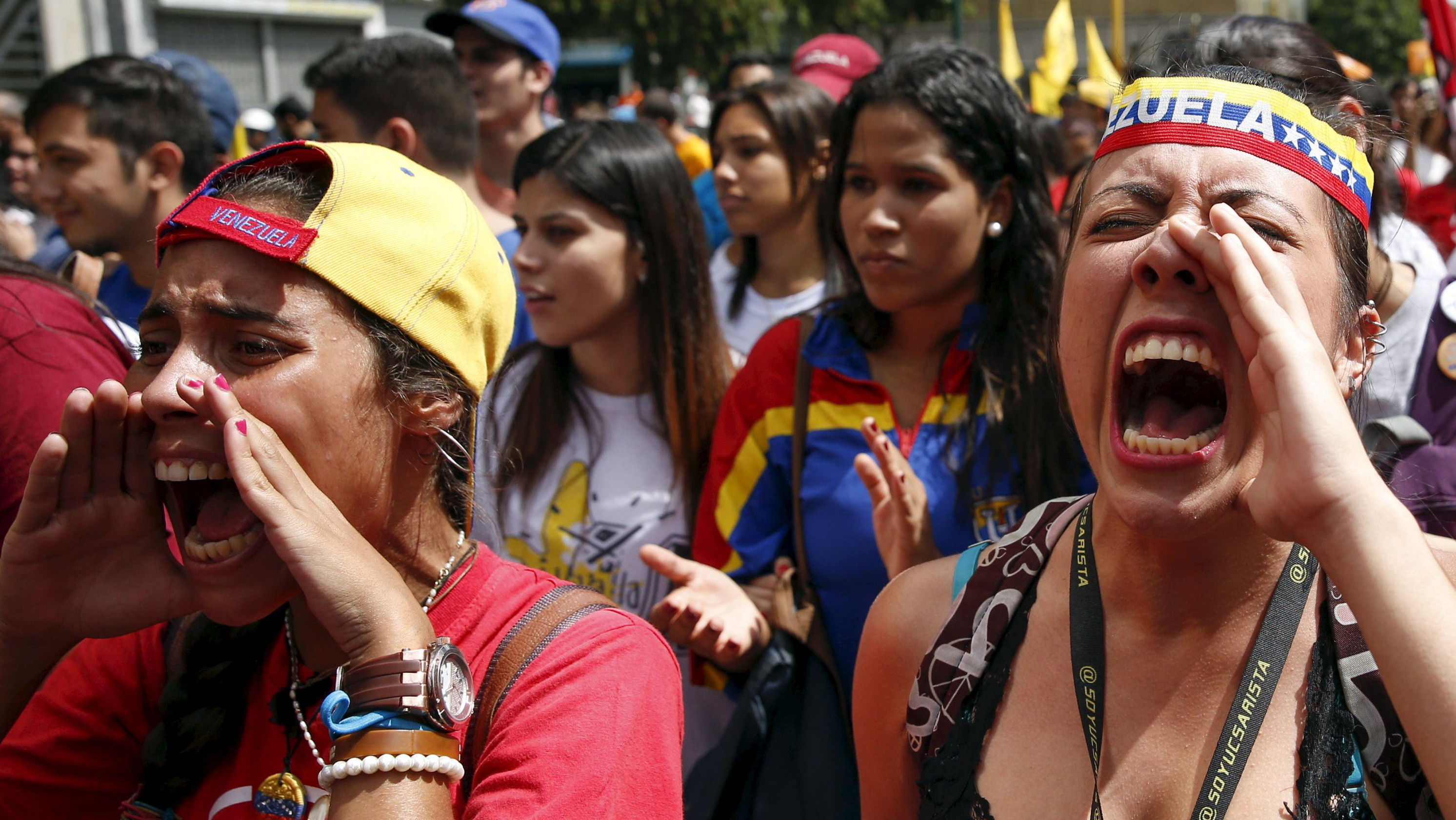 Opposition students shout slogans while they take part in a rally against President Nicolas Maduro's government on University Student Day, in Caracas