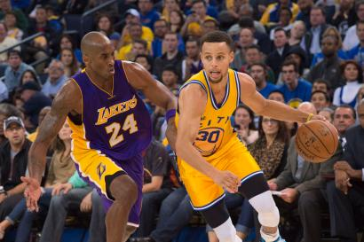 November 24, 2015; Oakland, CA, USA; Golden State Warriors guard Stephen Curry (30) dribbles the basketball against Los Angeles Lakers forward Kobe Bryant (24) during the third quarter at Oracle Arena. The Warriors defeated the Lakers 111-77. Mandatory Credit: Kyle Terada-USA TODAY Sports - RTX1VPT2