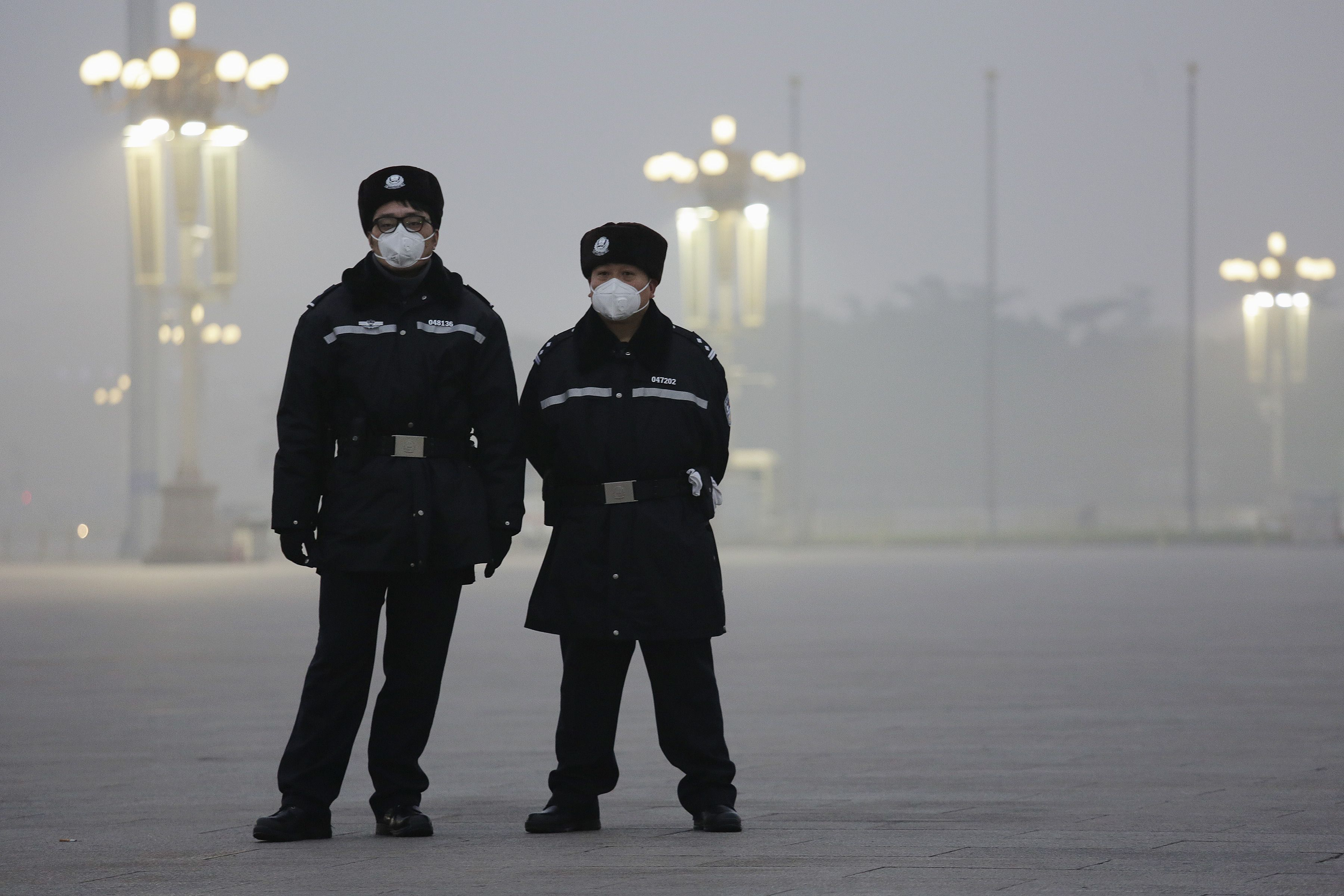 Policemen in protective masks at Tiananmen Square.
