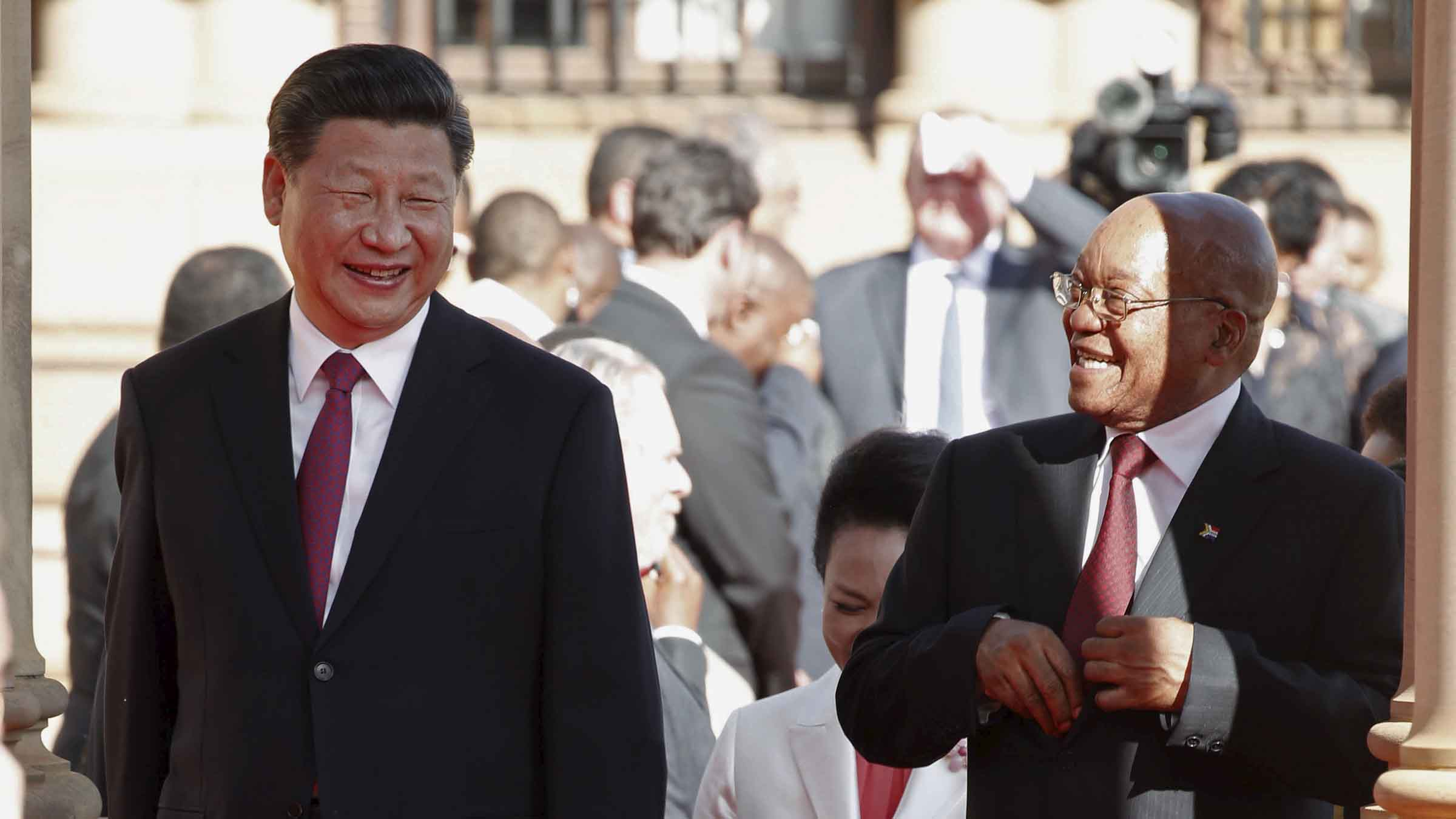 Chinese President Xi Jinping walks with South African President Jacob Zuma upon his arrival at the Union Buildings in Pretoria