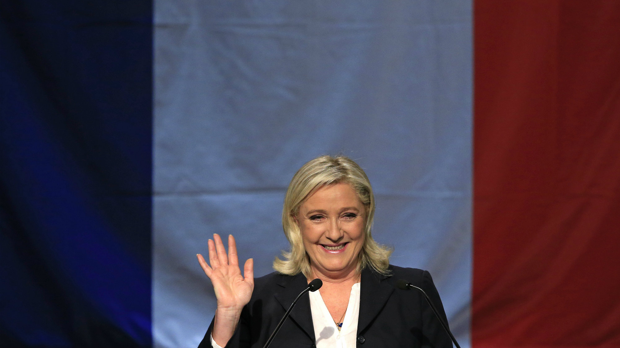 French National Front political party leader and candidate Marine Le Pen arrives to deliver her speech after the announcement of the results during the first round of the regional elections in Henin-Beaumont, France, December 6, 2015.