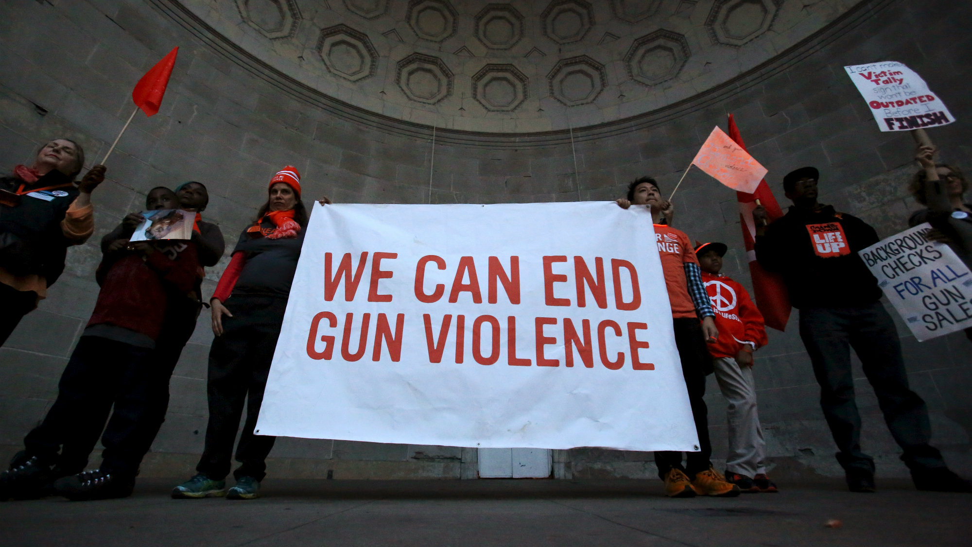 People stand in Central Park's Naumburg Bandshell during a march against gun violence, held ahead of...