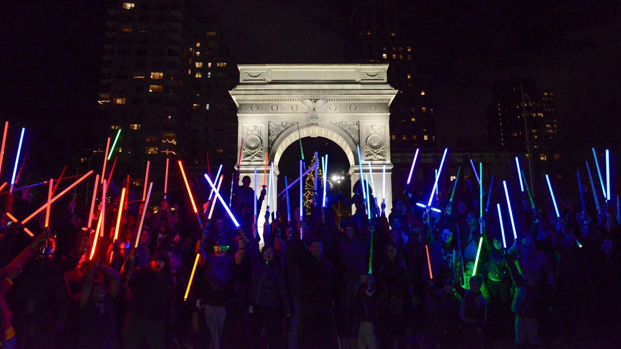 People participate in a Star Wars themed lightsaber battle in Washington Square Park in New York, December 18, 2015.
