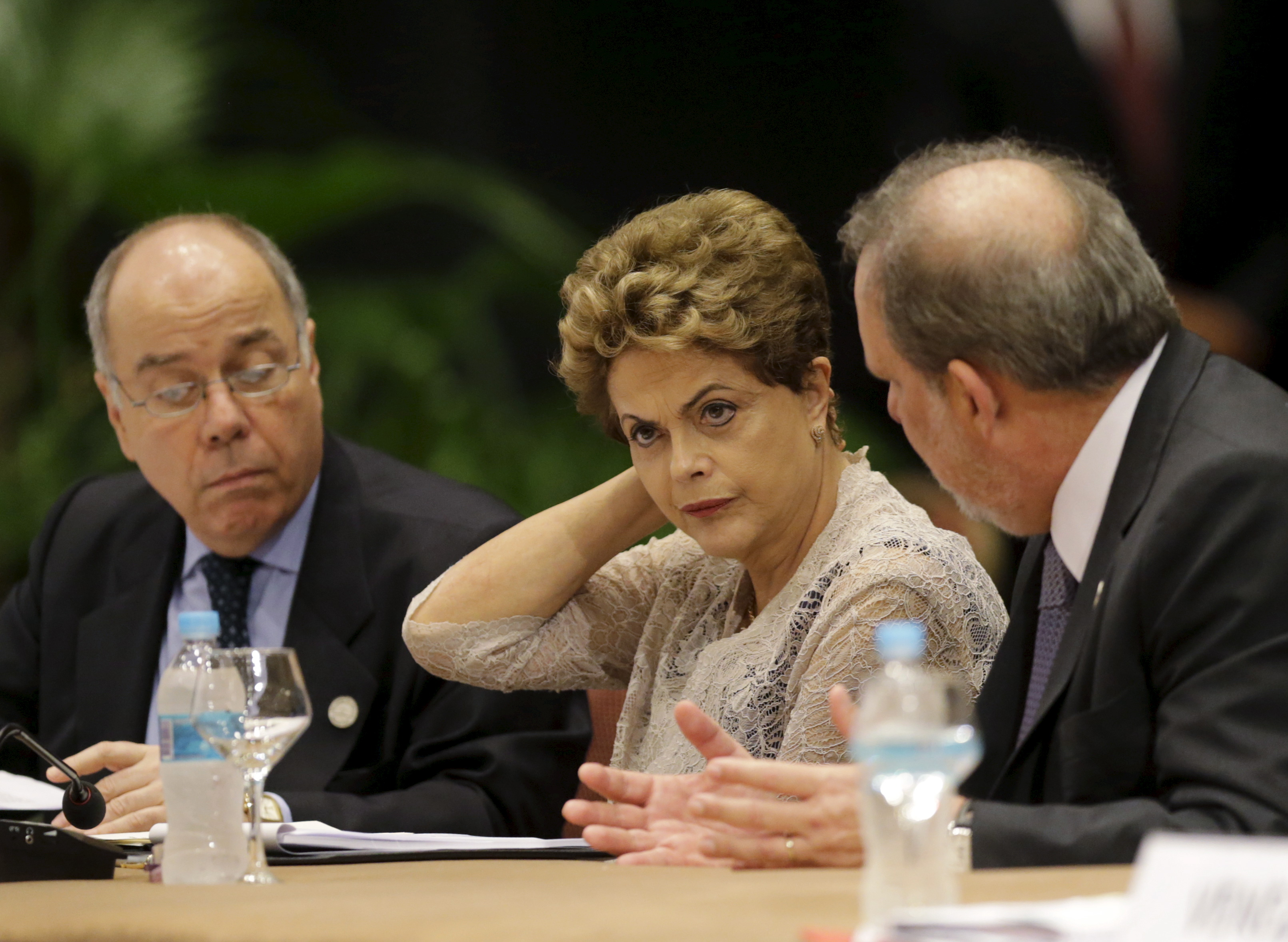 Brazil's Foreign Minister Mauro Viera (L), Brazil's President Dilma Rousseff (C) and Brazil's Minister for Development, Industry and Trade Armando Monteiro attend a session of the Summit of Heads of State of MERCOSUR and Associated States and 49th Meeting of the Common Market Council in Luque, Paraguay.