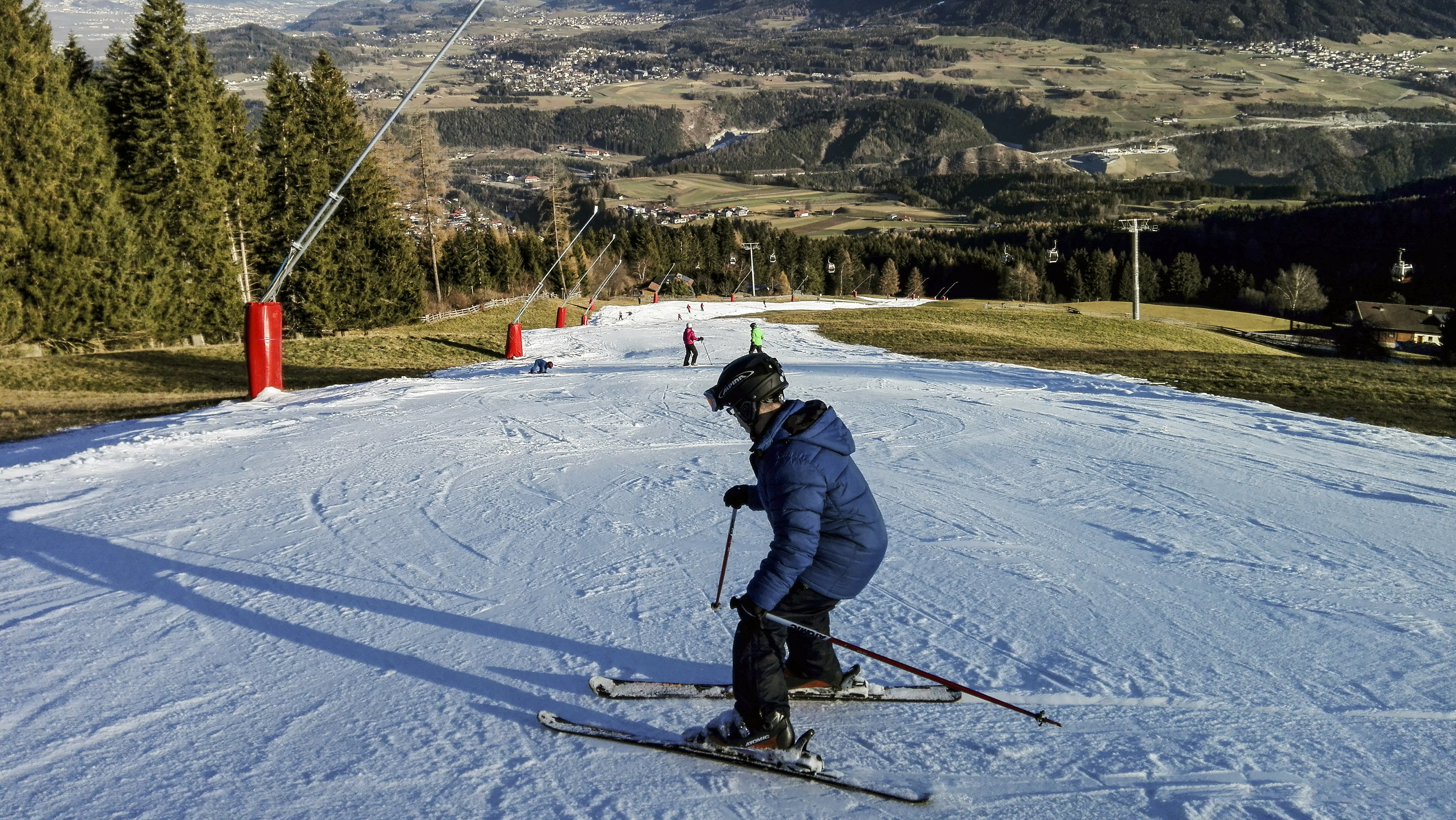 A skier skis down a patch of artificial snow in the ski resort of Mutters