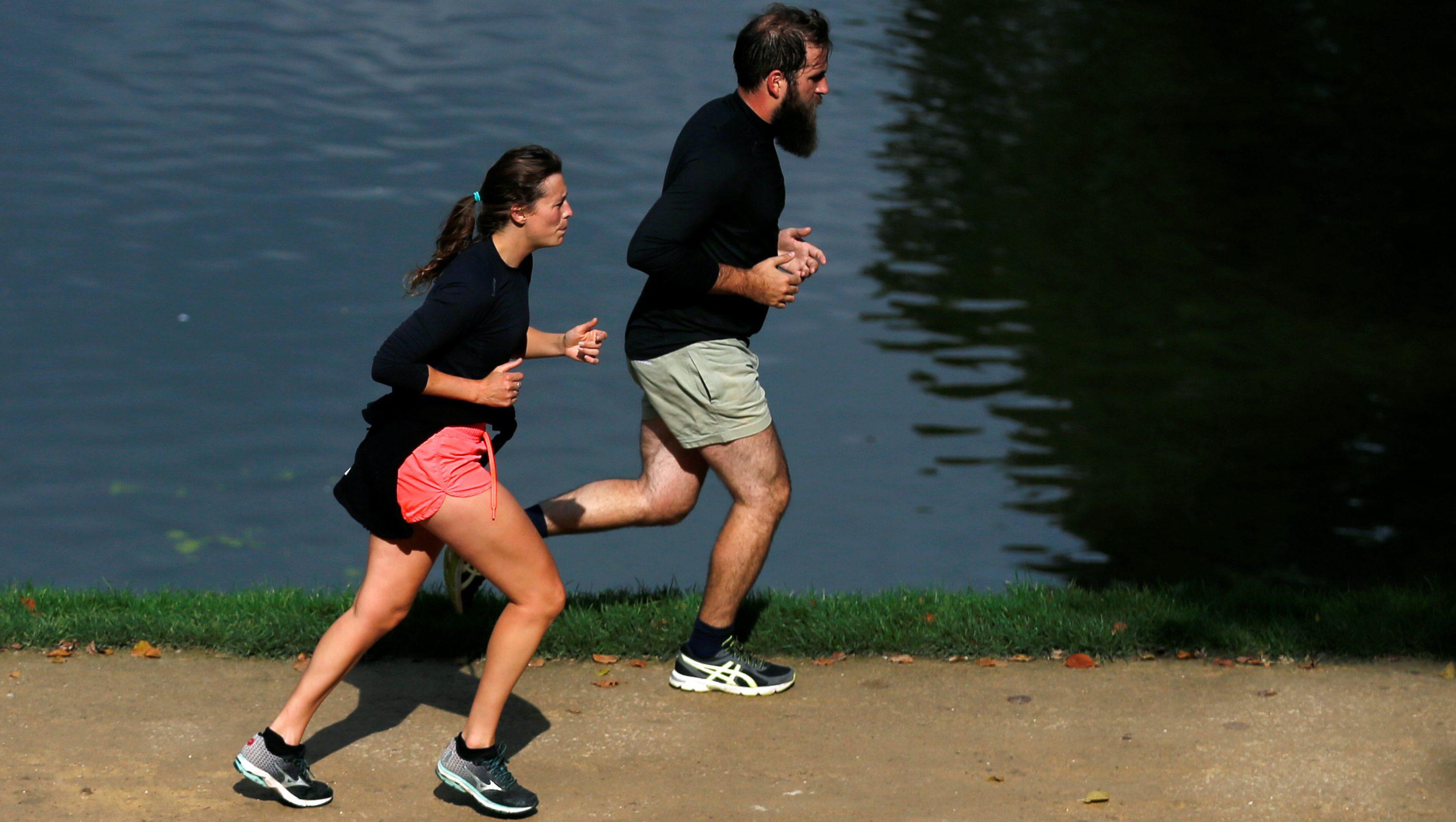 People jog in a public park in Brussels