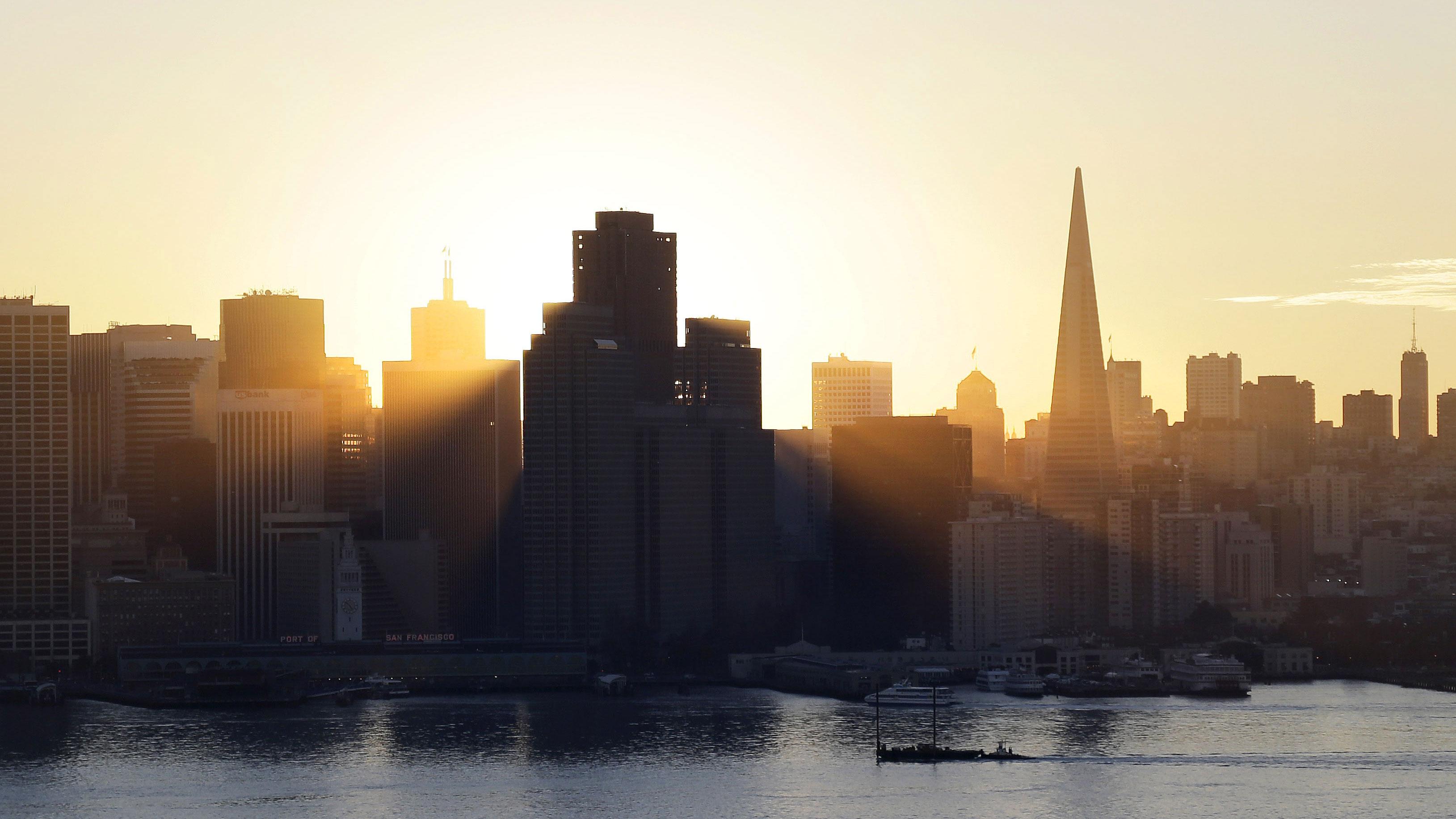 The sun sets behind the city skyline on Wednesday, Jan. 7, 2015, in San Francisco. (AP Photo/Marcio Jose Sanchez)