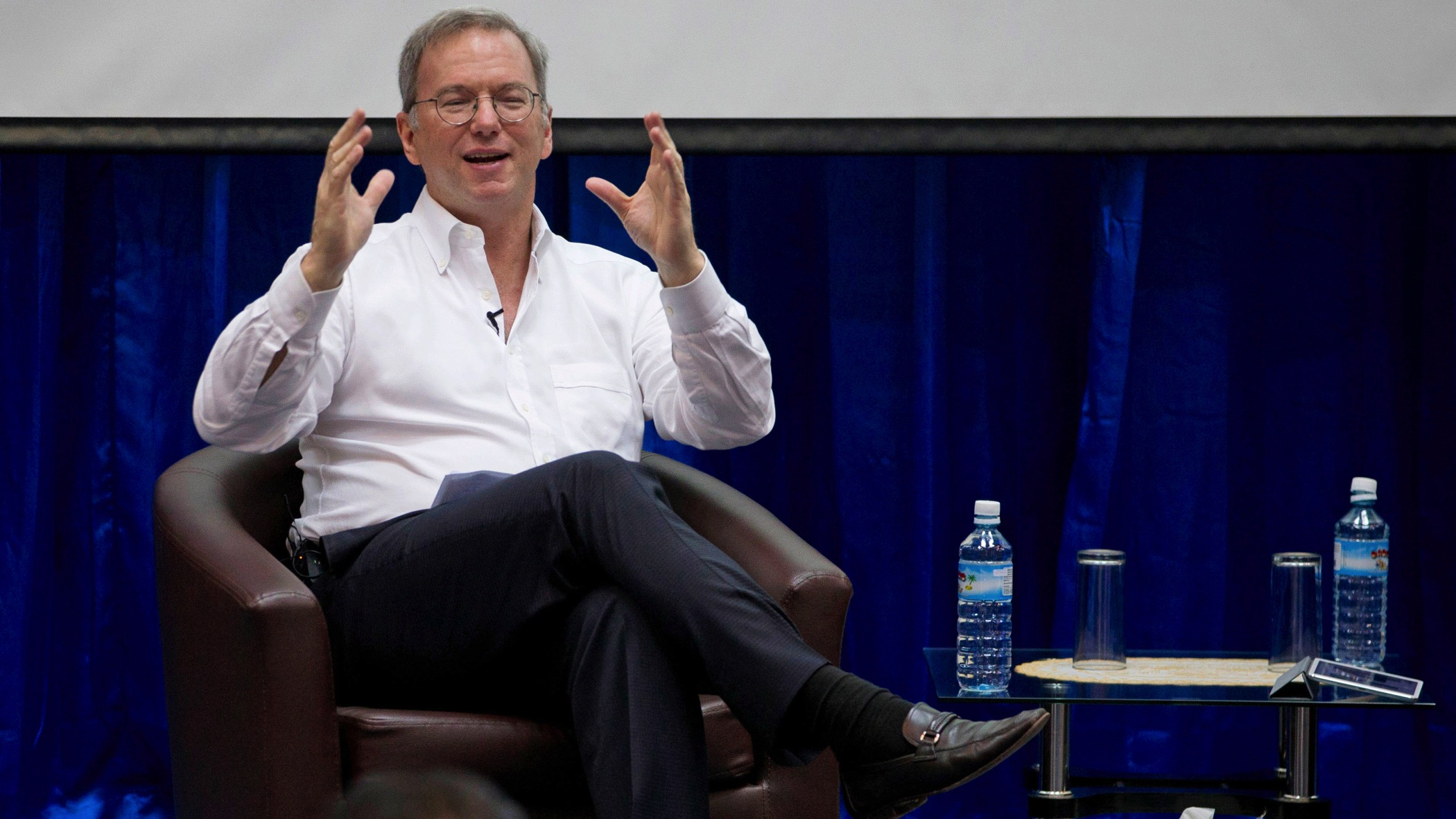 """Google executive chairman Eric Schmidt gestures during  an interactive session with group of students at a technical university in Yangon, Myanmar, Friday, Mar 22, 2013. Schmidt on Friday urged Myanmar's government to allow the private sector to develop the country's woeful telecommunications infrastructure, emphasizing the importance of competition and free speech. Schmidt's visit to Myanmar comes after trips to Libya, Afghanistan, and North Korea, which he said was a """"truly wacky place."""" (AP Photo/Gemunu Amarasinghe)"""