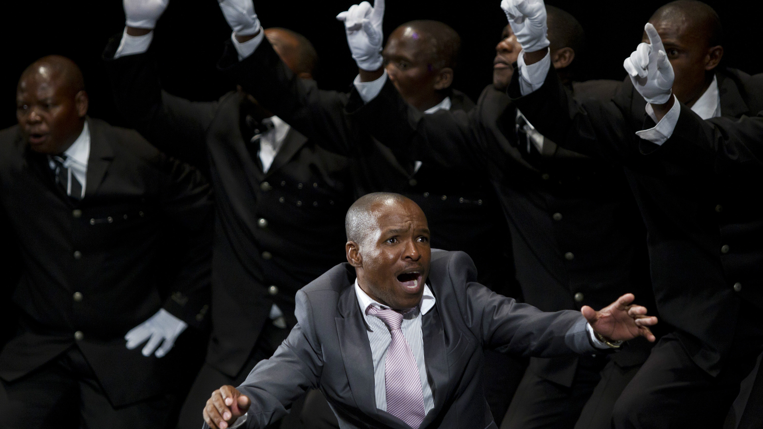 A traditional Isicathamiya group performs during a competition in Durban September 24, 2011. The Isicathamiya Festival held on South Africa's Heritage Day saw 111 groups competing in a genre made known worldwide by South African musical group Ladysmith Black Mambazo. Isicathamiya groups consist mainly of men who sing acapella and perform tightly choreographed dance moves which keep the singers on their toes. REUTERS/Rogan Ward (SOUTH AFRICA - Tags: SOCIETY ENTERTAINMENT TPX IMAGES OF THE DAY)