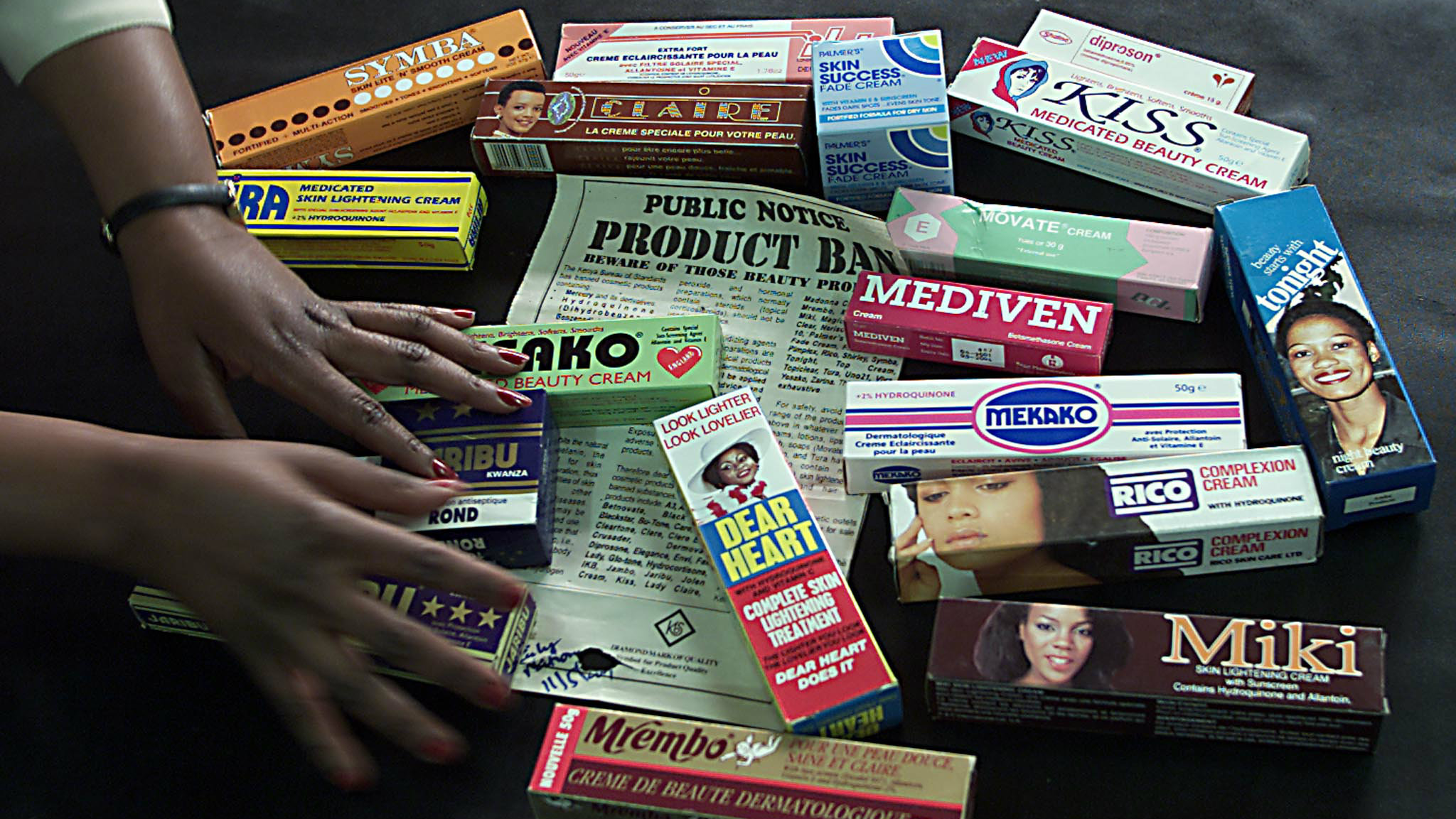 A beautician displays banned skin lighteners August 1, 2001 in Nairobi. The Kenyan government through the Kenya Bureau of Standards recently banned the sale of the skin lightening products, but many of the products are still on shop shelves. Picture taken August 1, 2001. REUTERS/George Mulala TO GO WITH STORY SLUGGED LIFE-AFRICA-SKINLIGHTENING.