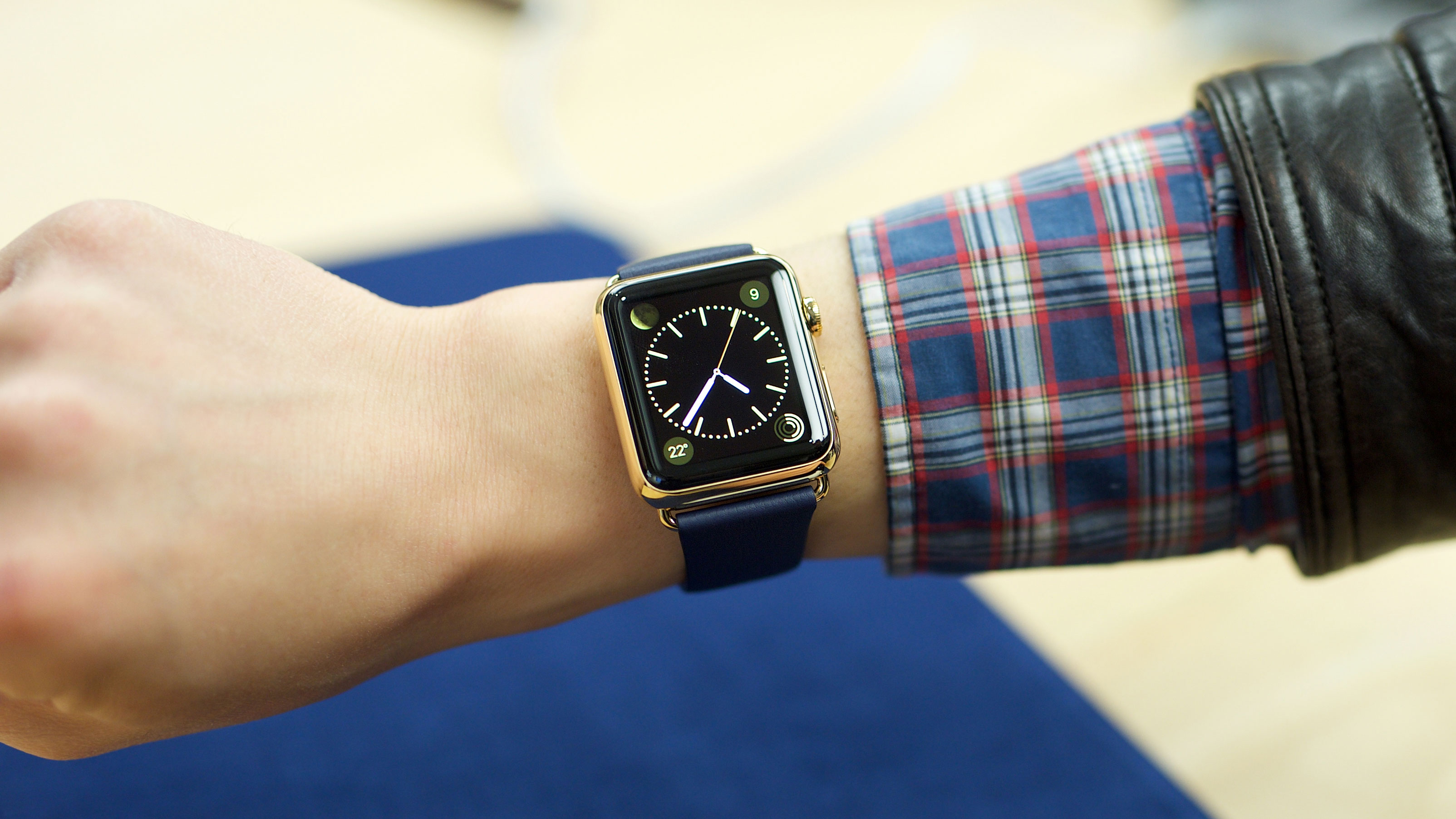 IMAGE DISTRIBUTED FOR APPLE - An excited customer tries on the Apple Watch Edition at the Eaton Centre Apple Store on Friday, April 10, 2015 in Toronto. (Photo by Ryan Emberley/Invision for Apple/AP Images)