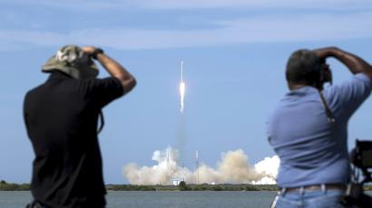 Photographers take pictures of the unmanned SpaceX Falcon 9 rocket with Dragon lifts off from launch pad 40 at the Cape Canaveral Air Force Station in Cape Canaveral, Florida April 14, 2015.