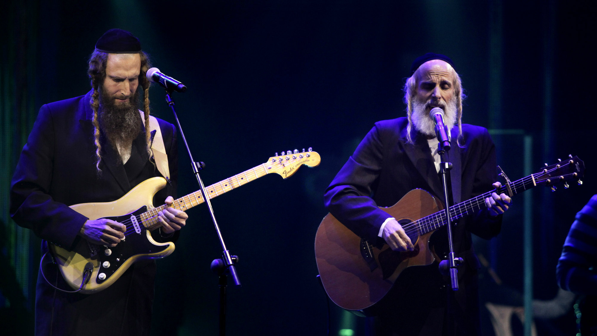 Ultra-Orthodox Jewish singers Arie Gat, right, and his brother Gil, perform as they participate in an Israeli tv show in Neve Ilan, Jerusalem.