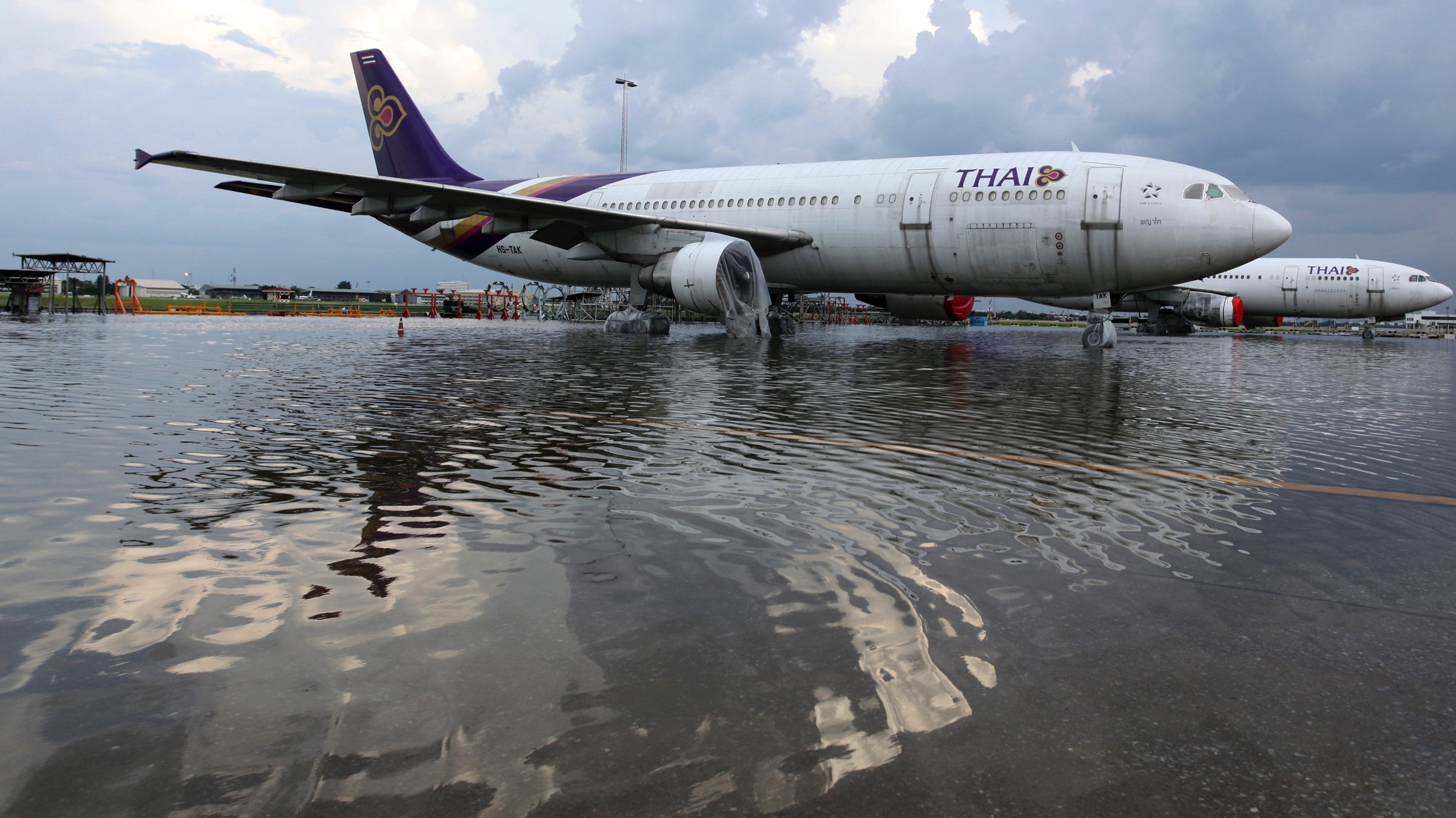 Engines of Thai Airways Airbus A300 planes are protected as floods advanced at the Don Muang airport in Bangkok