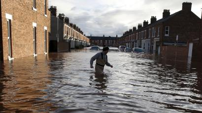 DATE IMPORTED:December 06, 2015A local man wades through flood water on a residential street in Carlisle, Britain December 6, 2015. British police have declared a major incident in northern England after prolonged heavy rain caused widespread flooding and forced emergency services to evacuate residents from their homes. REUTERS/Phil Noble