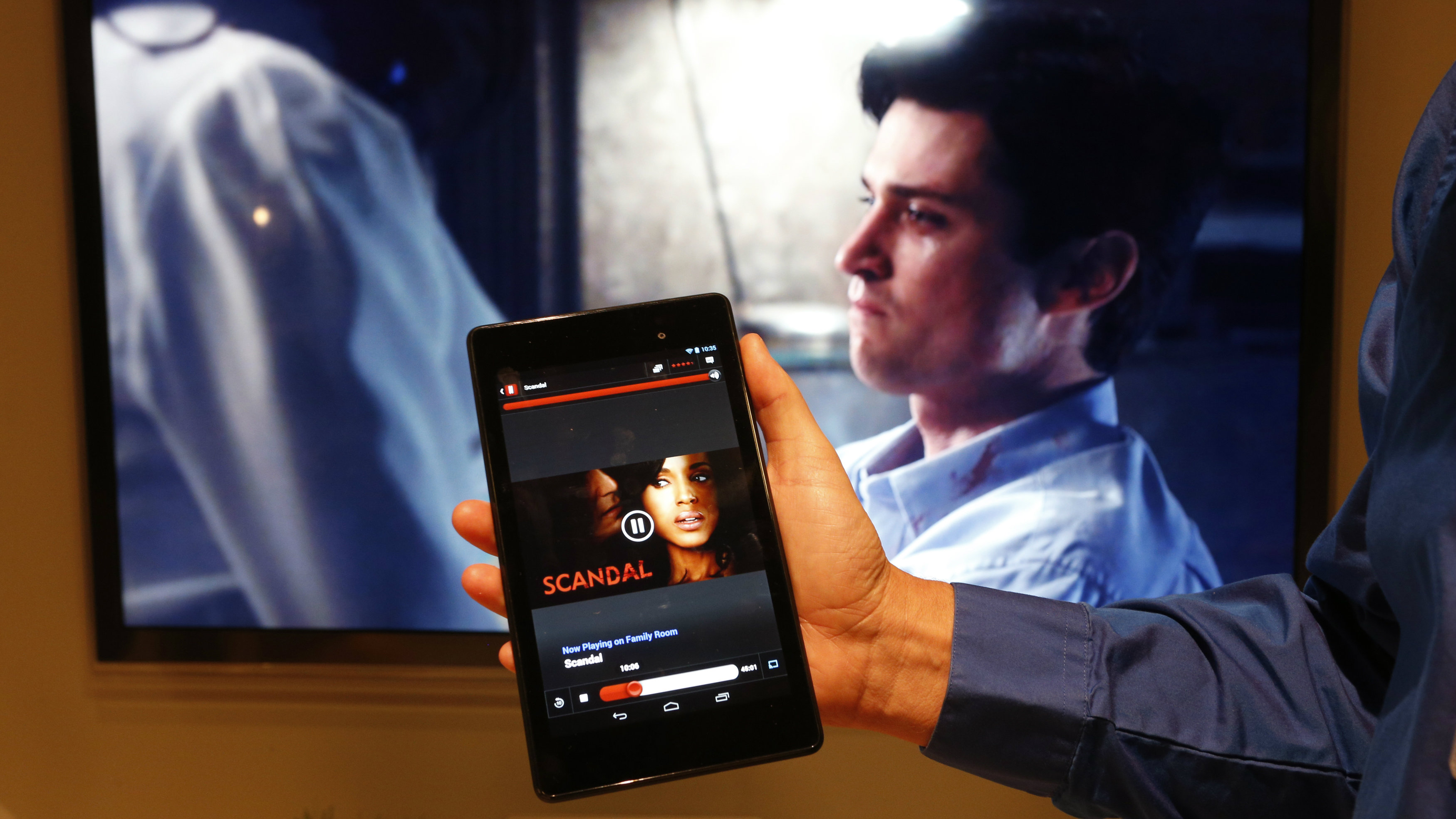 Michael Sundermeyer, of Google, demonstrates Google's new Chromecast device synching between a television and the new Nexus 7 tablet during a Google event at Dogpatch Studio in San Francisco, California, July 24, 2013.