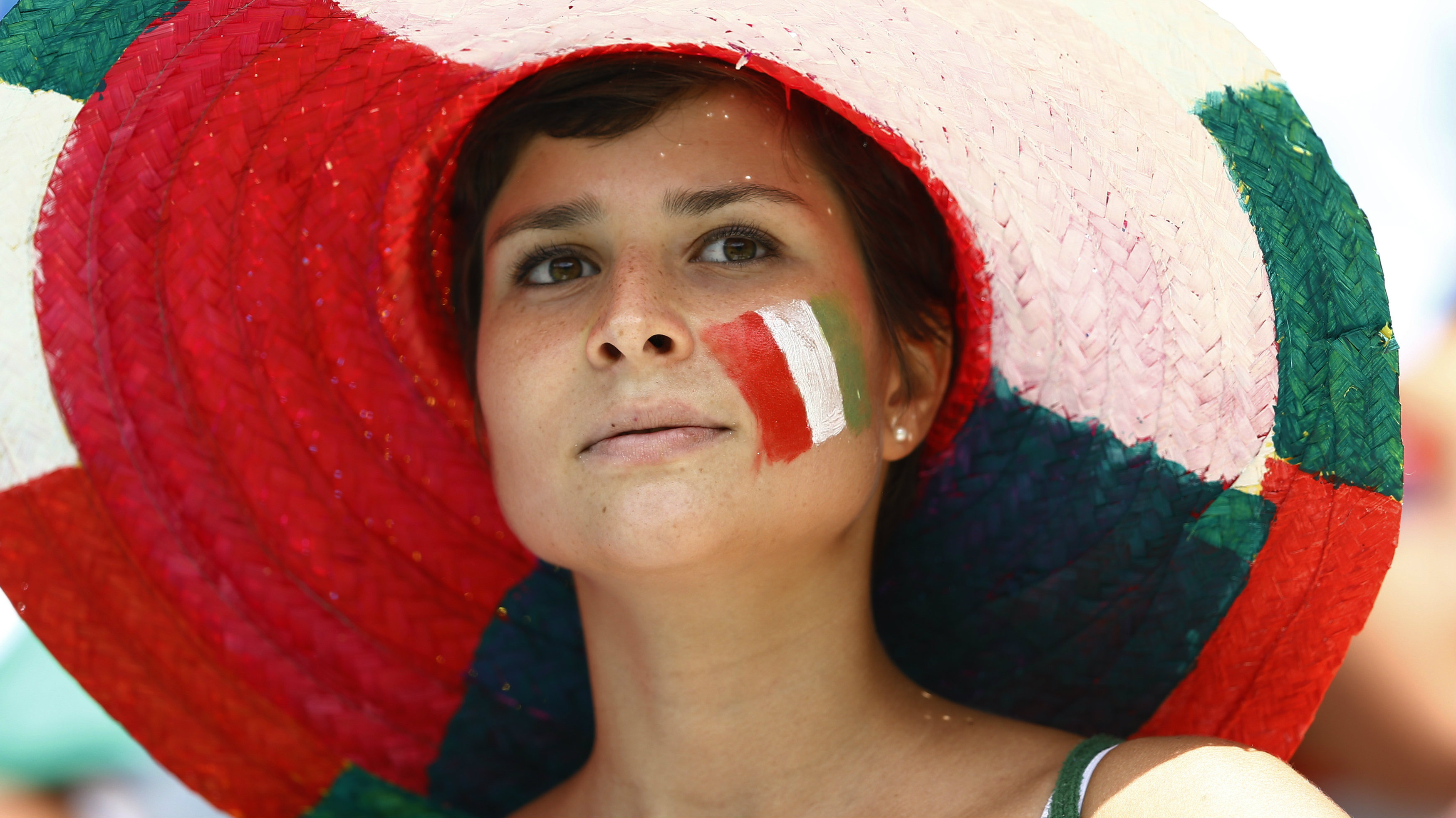 A fan of Italy with an image of the national flag painted on her face, is pictured before their 2014 World Cup Group D soccer match against Costa Rica at the Pernambuco arena in Recife June 20, 2014. REUTERS/Dominic Ebenbichler