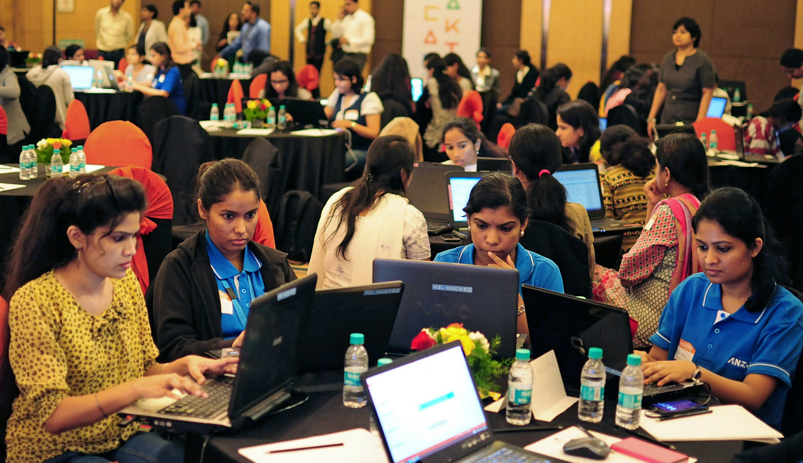 Women take part in a Hackathon as part of the Grace Hopper Celebration of Women in Computing, Bangalore, India, 19 November 2014. Over one hundred software professionals and students took part in the event themed 'Tech for Good' for ethical hackers, a day long coding event to build applications which could benenfit society.