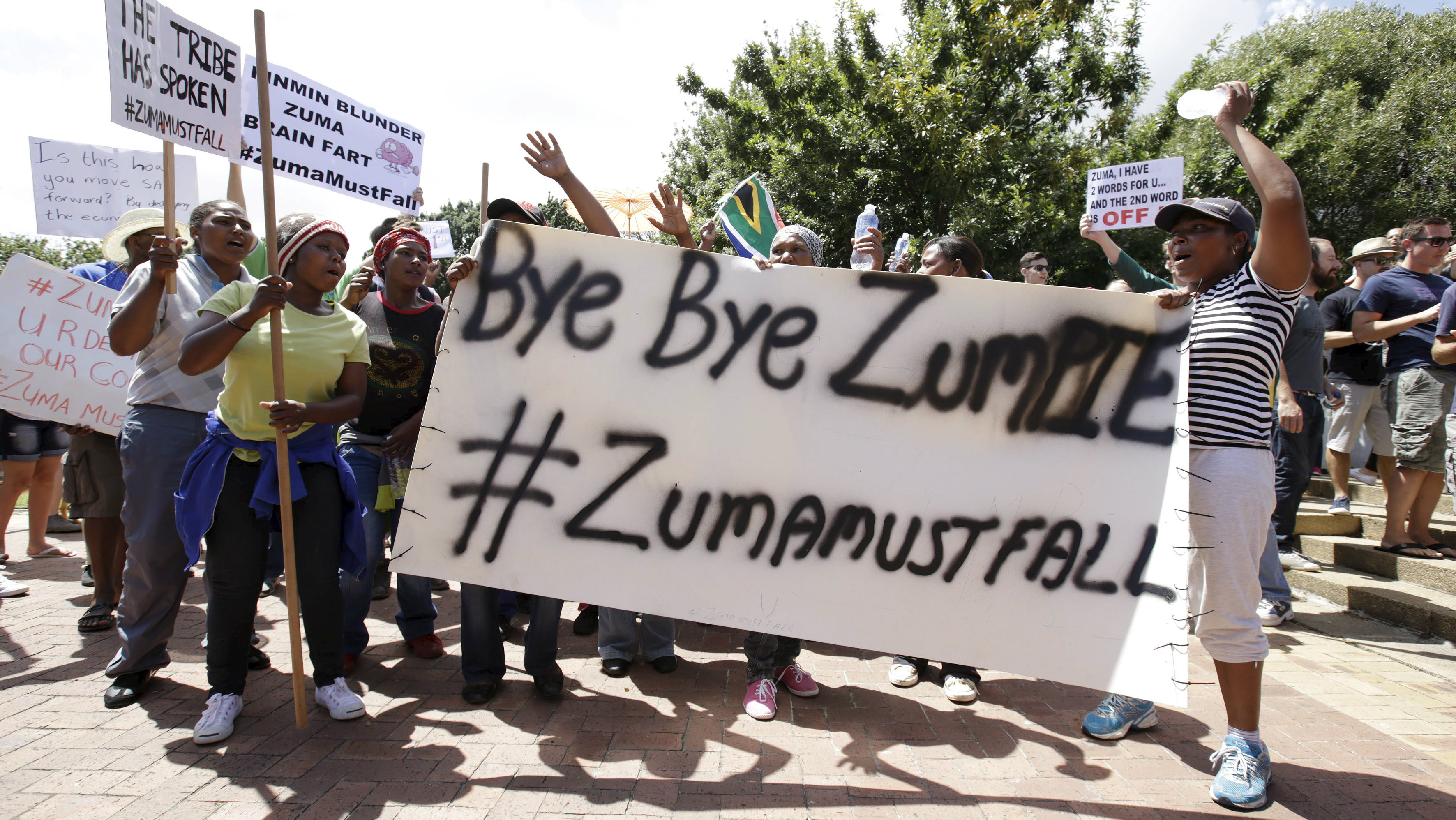 Protesters carry placards as they take part in a demonstration against President Jacob Zuma in Cape town, South Africa, December 16, 2015.
