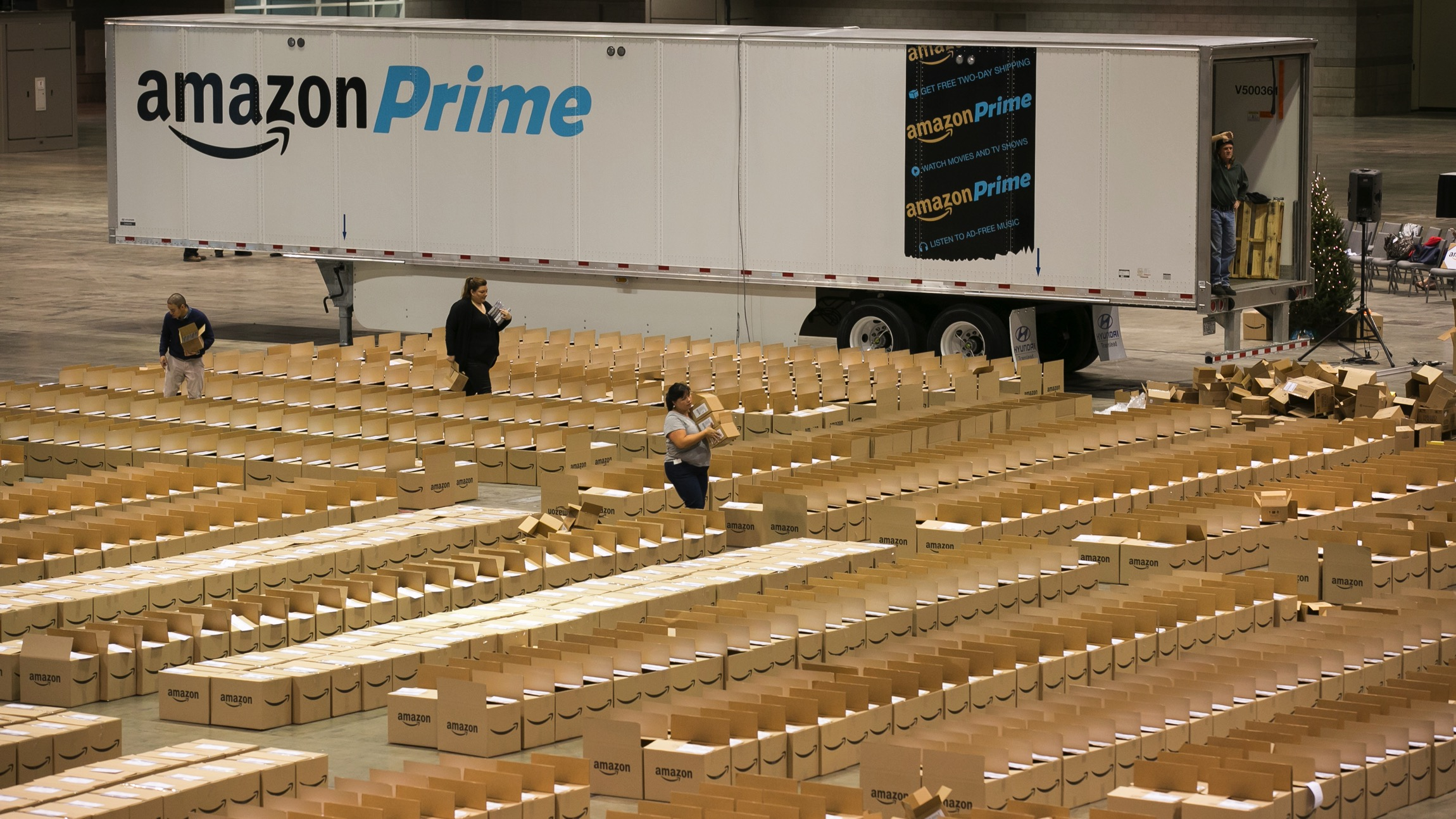 "At an event today in Chicago, Amazon employees from nearby fulfillment centers packed 2,000 care packages to send to soldiers abroad who are not able to come home for the holidays Friday, December 4, 2015. Since 2010, Amazon has shipped more than 12 million packages to APO and FPO addresses. The Amazon care packages for the troops included holiday chocolates and snacks alongside an Amazon Fire tablet. The care packages for soldiers headed off in an Amazon branded trailer—one of thousands that Amazon has started to roll-out to increase capacity in the supply chain. Amazon's Vice President of North America Operations Mike Roth said, ""I couldn't be more pleased that our very first Amazon trailer headed out on the road carrying such special packages—thousands of boxes filled with beloved holiday items and Amazon Fire devices to support troops abroad this holiday season.  (Photo by Peter Wynn Thompson/AP Images for Amazon)"