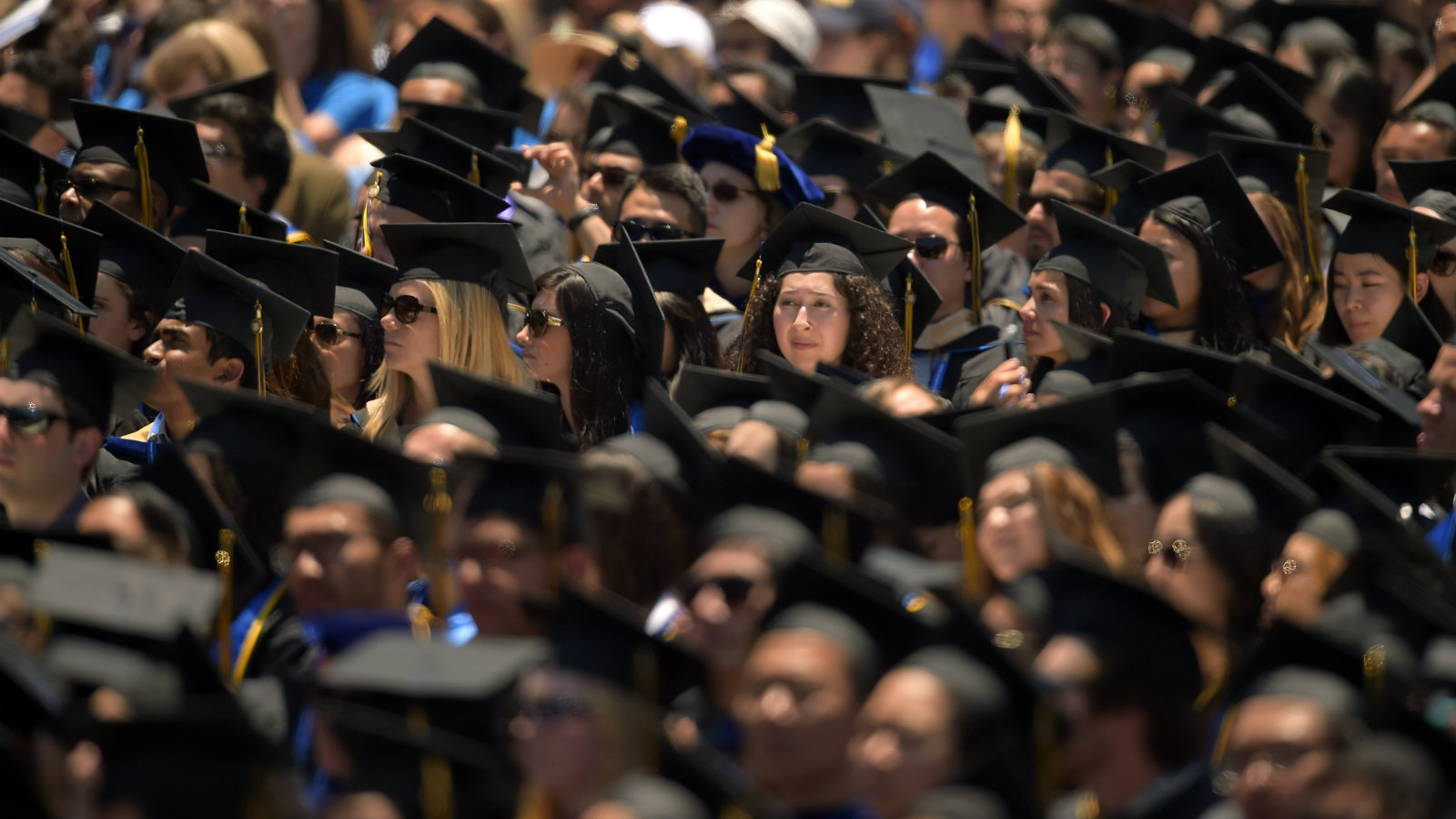 Students listen to President Barack Obama deliver the commencement address for the University of California, Irvine, Saturday, June 14, 2014, in Anaheim, Calif.