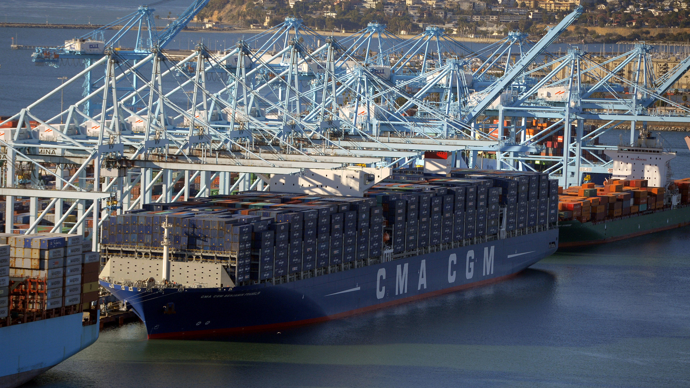 The largest container ship to ever make port in North America unloads its cargo in the Port of Los Angeles in San Pedro, Calif., on Saturday, Dec. 26, 2015. After making its maiden voyage from China, where it was built, the CMA CGM Benjamin Franklin arrived before dawn with its cargo. The ship can carry 18,000 twenty-foot equivalent units (TEUs), which is about a third more than the ships that currently dock in the Port of L.A. The vessel measures 1,300 feet long, 177 feet wide and is 197 feet tall and is staffed with a crew of 26. The giant ship is scheduled to leave Los Angeles on Wednesday, December 30 en route to Oakland before returning to China.