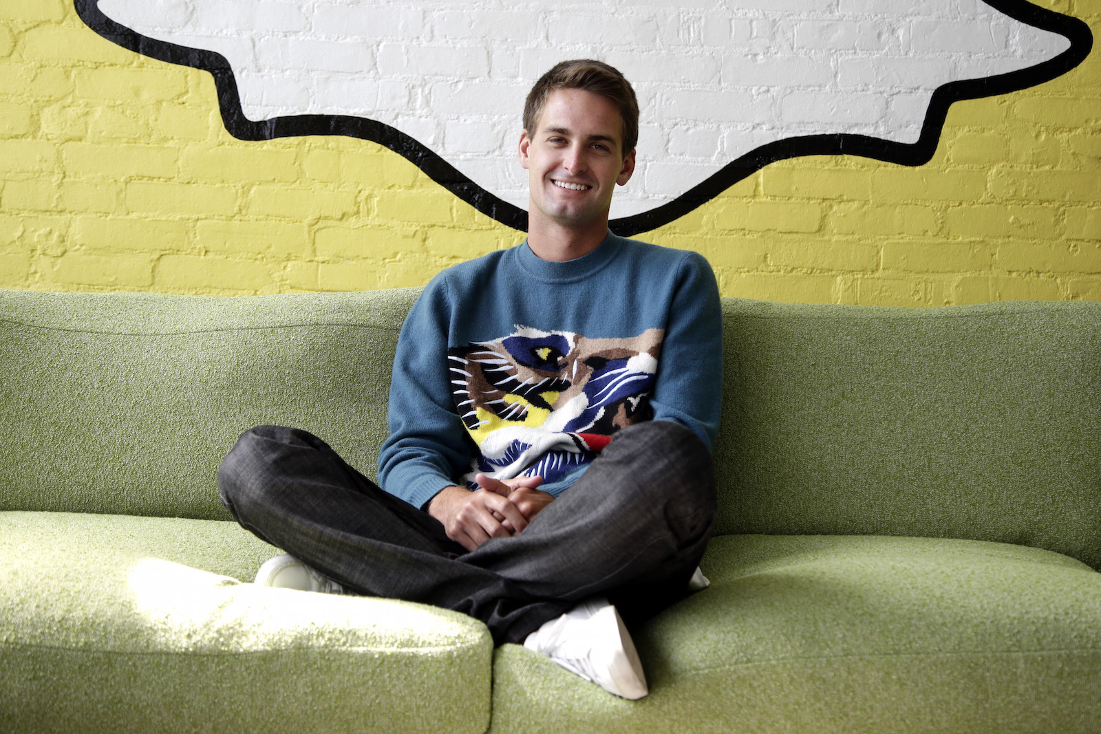In this Thursday, Oct. 24, 2013, Snapchat CEO Evan Spiegel poses for photos, in Los Angeles. Spiegel dropped out of Stanford University in 2012, three classes shy of graduation, to move back to his father's house and work on Snapchat. Spiegel's fast-growing mobile app lets users send photos, videos and messages that disappear a few seconds after they are received.