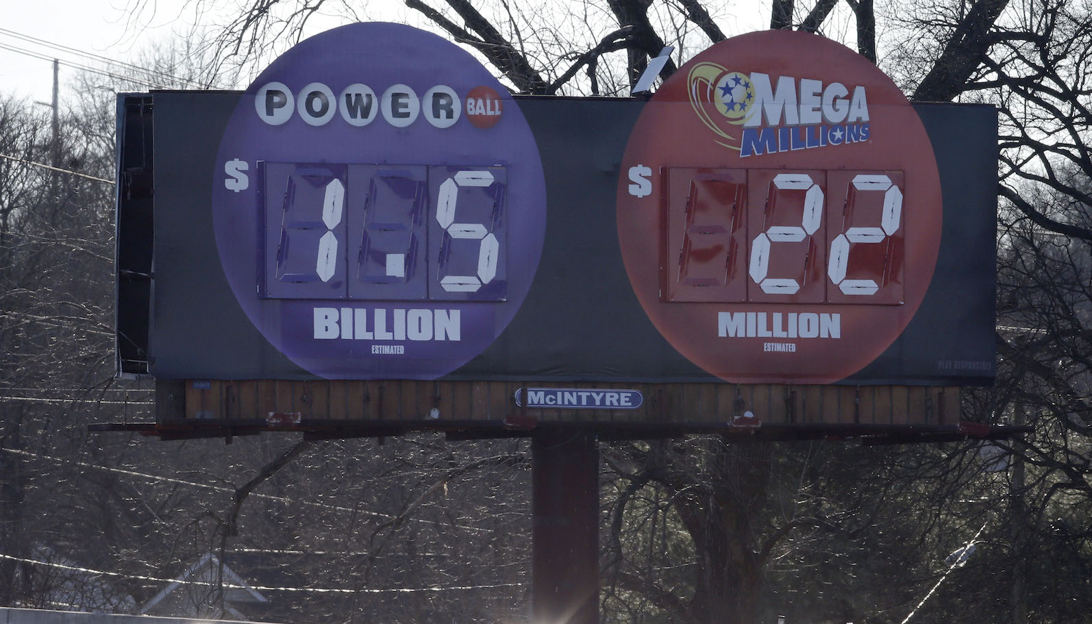 """Drivers pass a billboard where the word """"billion"""" has replaced """"million"""" to show the correct amount of the jackpot for Wednesday night's Powerball drawing on Wednesday, Jan. 13, 2016, in Nashville, Tenn. The top prize, now at more than $1 billion, is the largest lottery jackpot in the world. (AP Photo/Mark Humphrey)"""