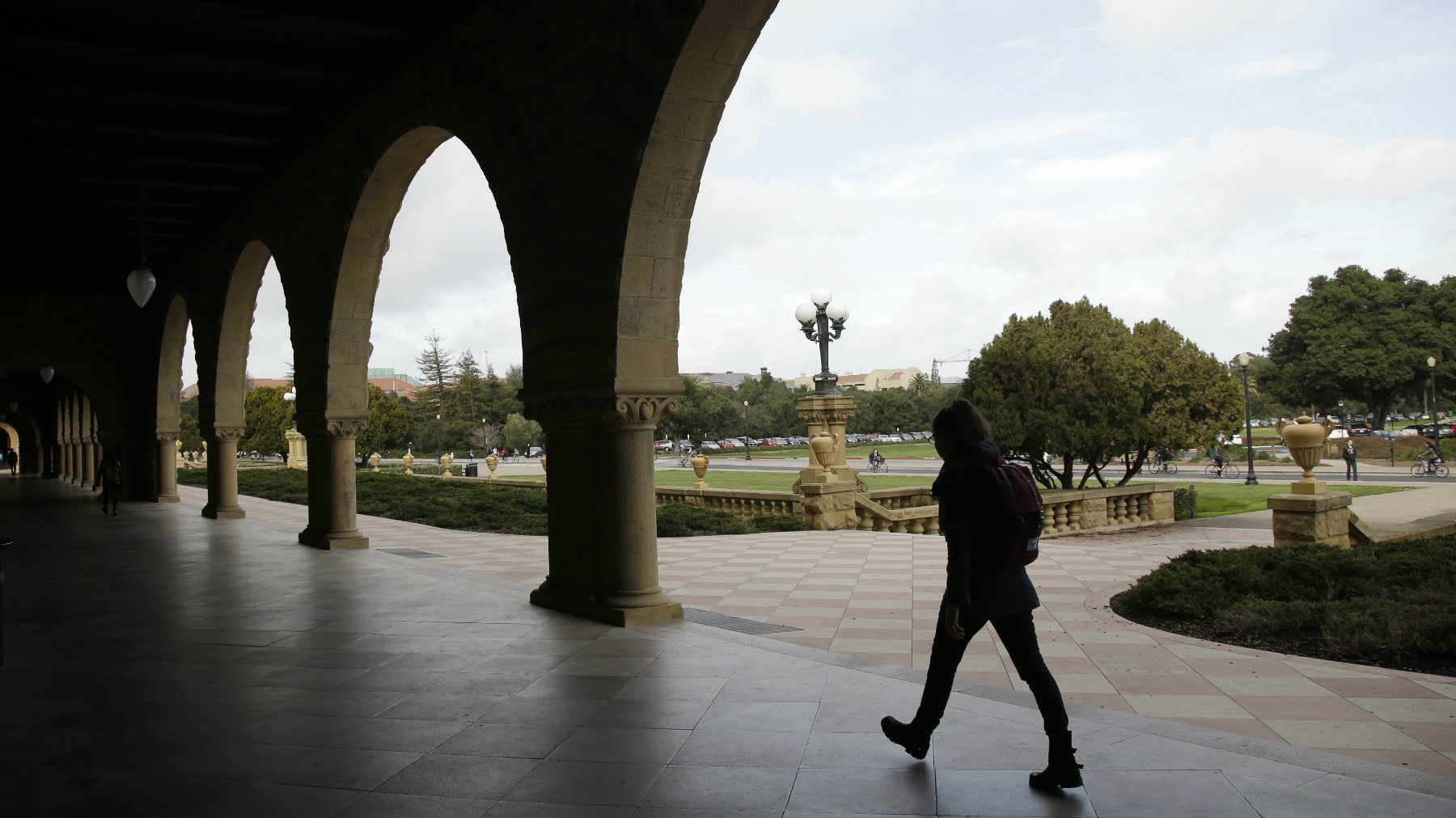 A student walks on campus at Stanford University.