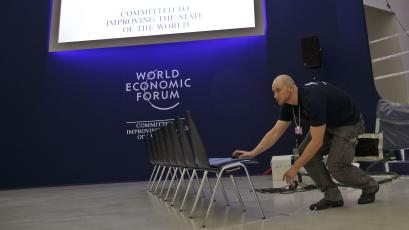 A technician lines up the chairs at the congress center where the World Economic Forum will take place later this week in Davos, Switzerland, Monday Jan. 18, 2016. The world's political and business elite are being urged to do more than pay lip service to growing inequalities around the world as they head off for this week's World Economic Forum in the Swiss ski resort of Davos this week. (AP Photo/Michel Euler)