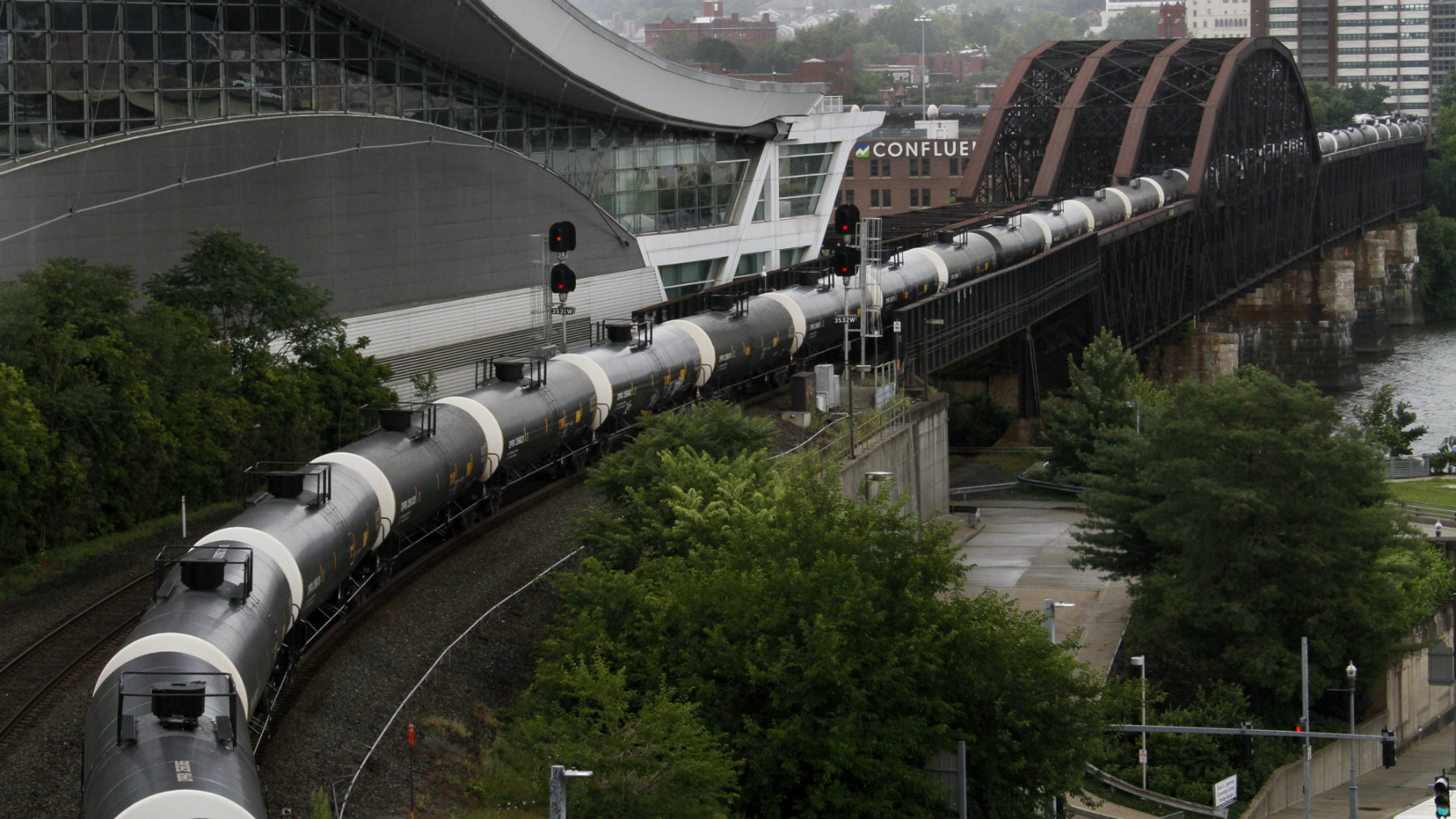 Tank cars on a Norfolk Southern freight train roll through downtown Pittsburgh, Pennsylvania.