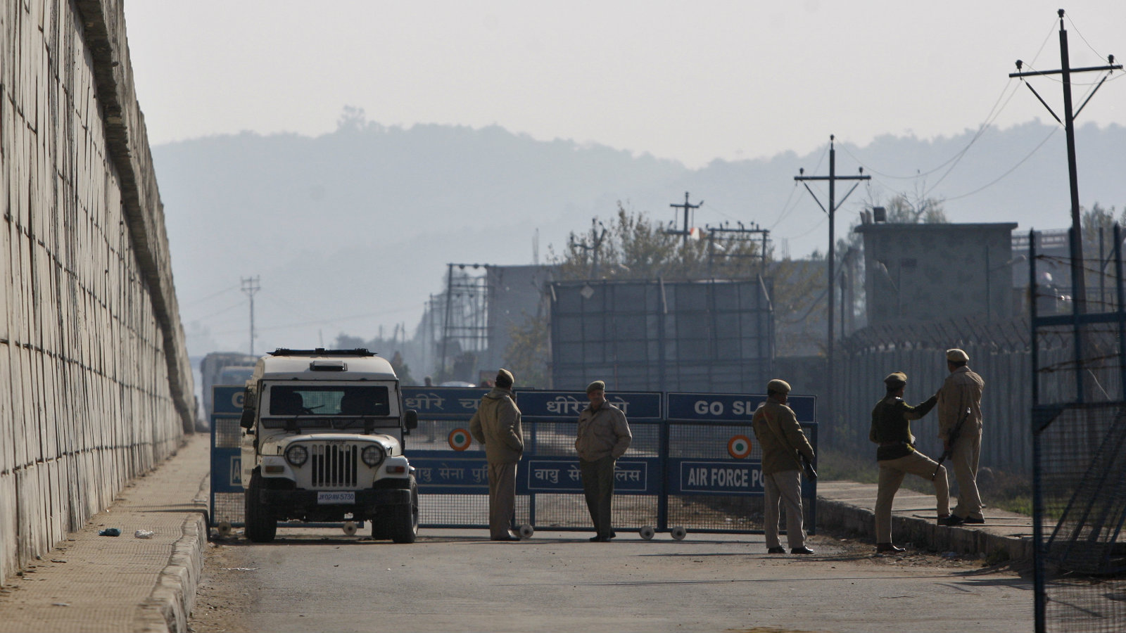 Indian security forces set up a road barrier outside an Indian air force base in Pathankot, 430 kilometers (267 miles) north of New Delhi, India, Saturday, Jan. 2, 2016. Gunmen attacked the air force base near the border with Pakistan on Saturday morning and exchanged fire with security forces, officials said.