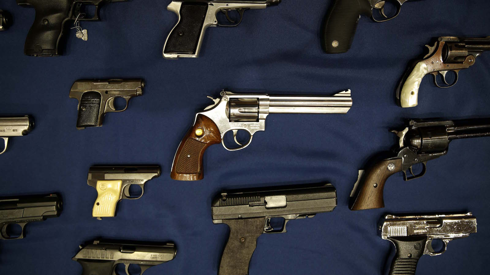 Guns seized by the police are displayed during a news conference in New York, Tuesday, Oct. 27, 2015. Officials announced charges Tuesday in a gun trafficking case where more than 70 firearms were seized. (AP Photo/Seth Wenig)