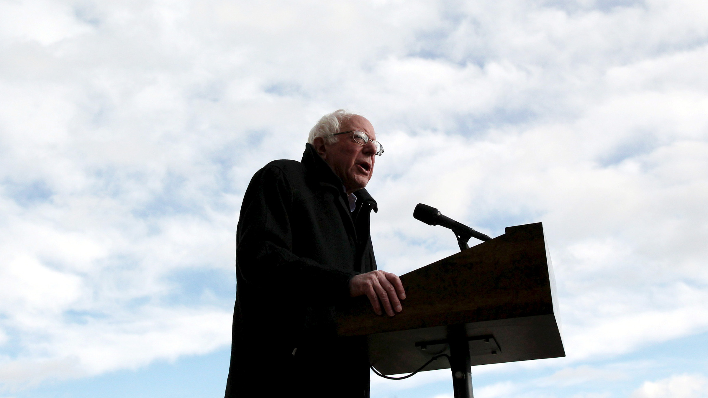 U.S. Democratic presidential candidate and Senator Bernie Sanders speaks to an overflow crowd before heading inside for a campaign rally in Amherst, Massachusetts January 2, 2016.