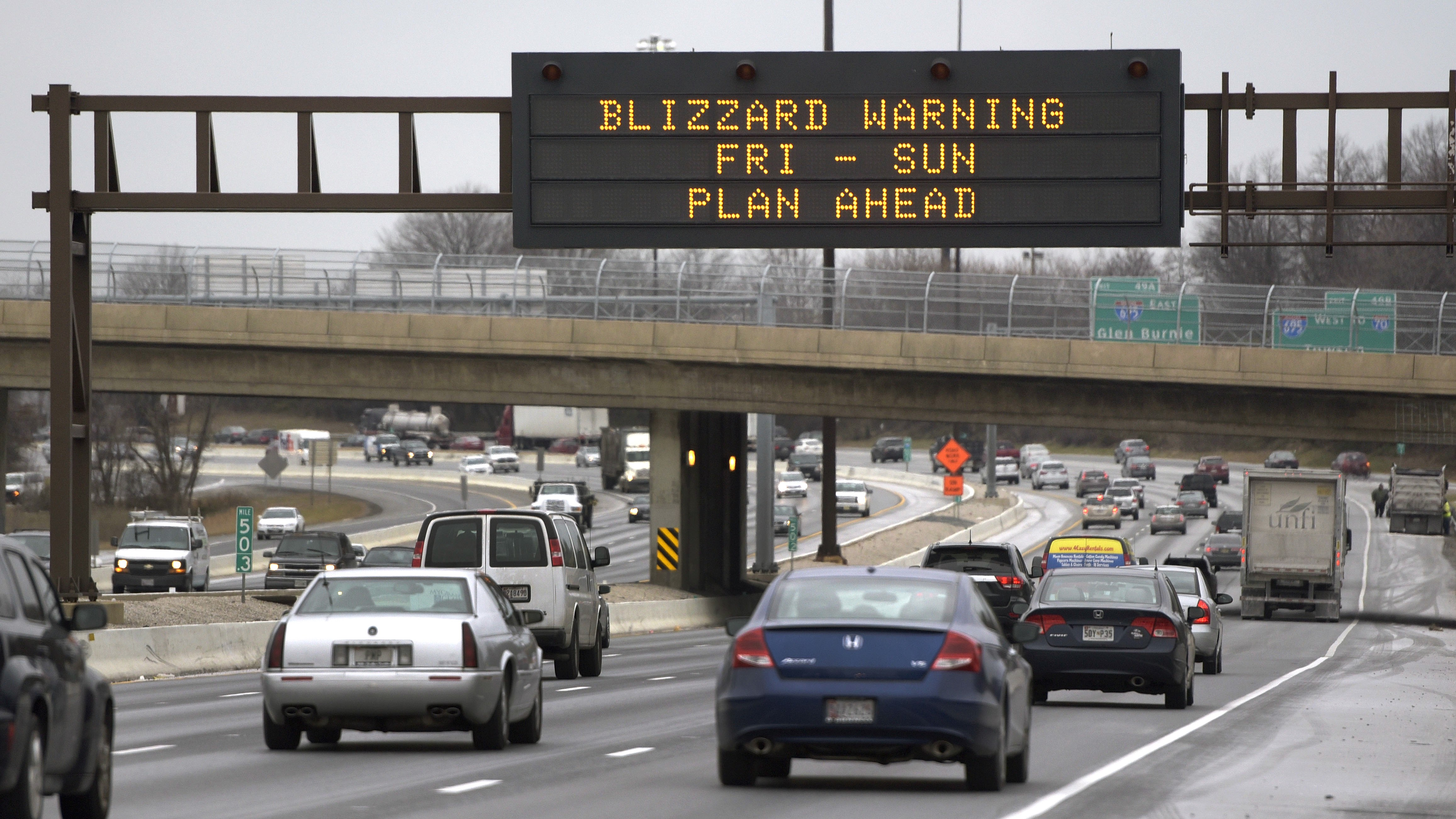 A sign warns south-bound motorists on Interstate 95 of an expected snowstorm, Friday, Jan. 22, 2016, in Baltimore. The northern mid-Atlantic region, including Baltimore, Washington and Philadelphia, is preparing for a weekend snowstorm that is now forecast to reach blizzard conditions. (AP Photo/Steve Ruark)