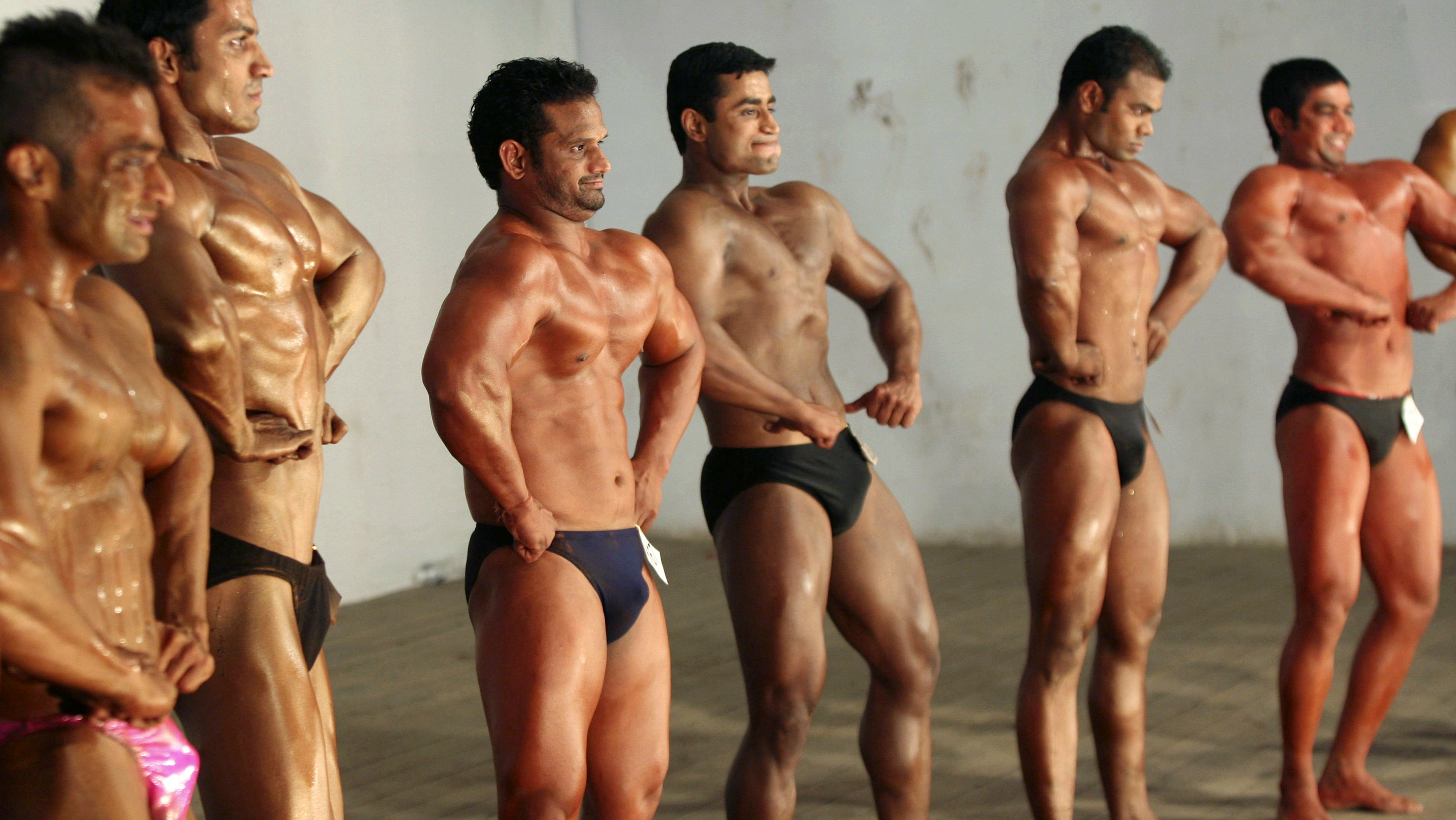 "Competitors flex their muscles during the ""Mr. Senior Gujarat 2010"" bodybuilding contest in the western Indian city of Ahmedabad January 31, 2010. More than 200 body builders across the state on Sunday participated in a contest organised by the Gujarat state body building association in an aim to encourage youth in body building sports and to aware common people about their health, a media release said. Picture taken January 31, 2010. REUTERS/Amit Dave (INDIA - Tags: SOCIETY)"