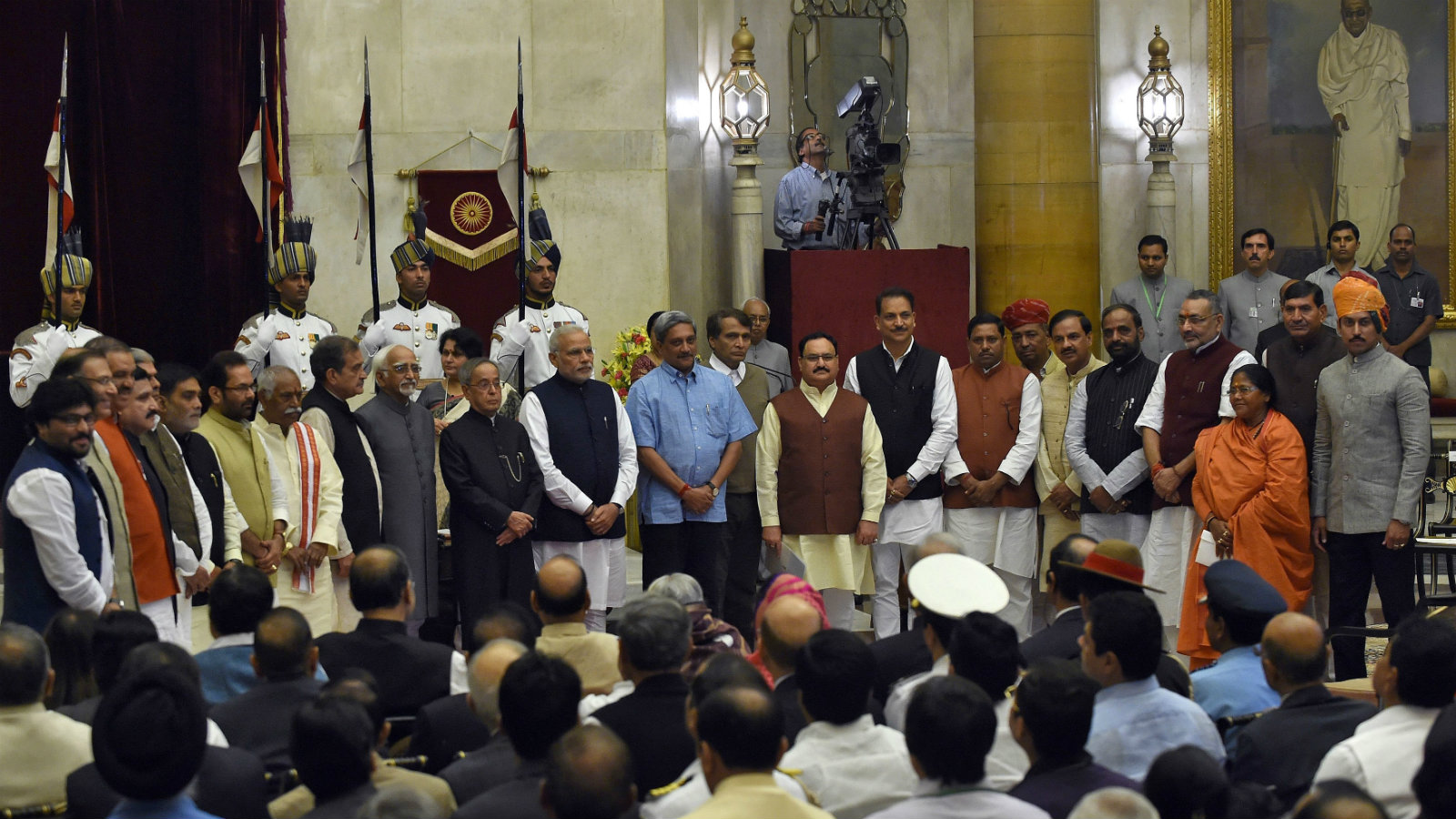 India's President Pranab Mukherjee (12th L) and Prime Minister Narendra Modi (13th L) pose with new cabinet ministers after a swearing-in ceremony at the presidential palace in New Delhi November 9, 2014. Picture take November 9, 2014.