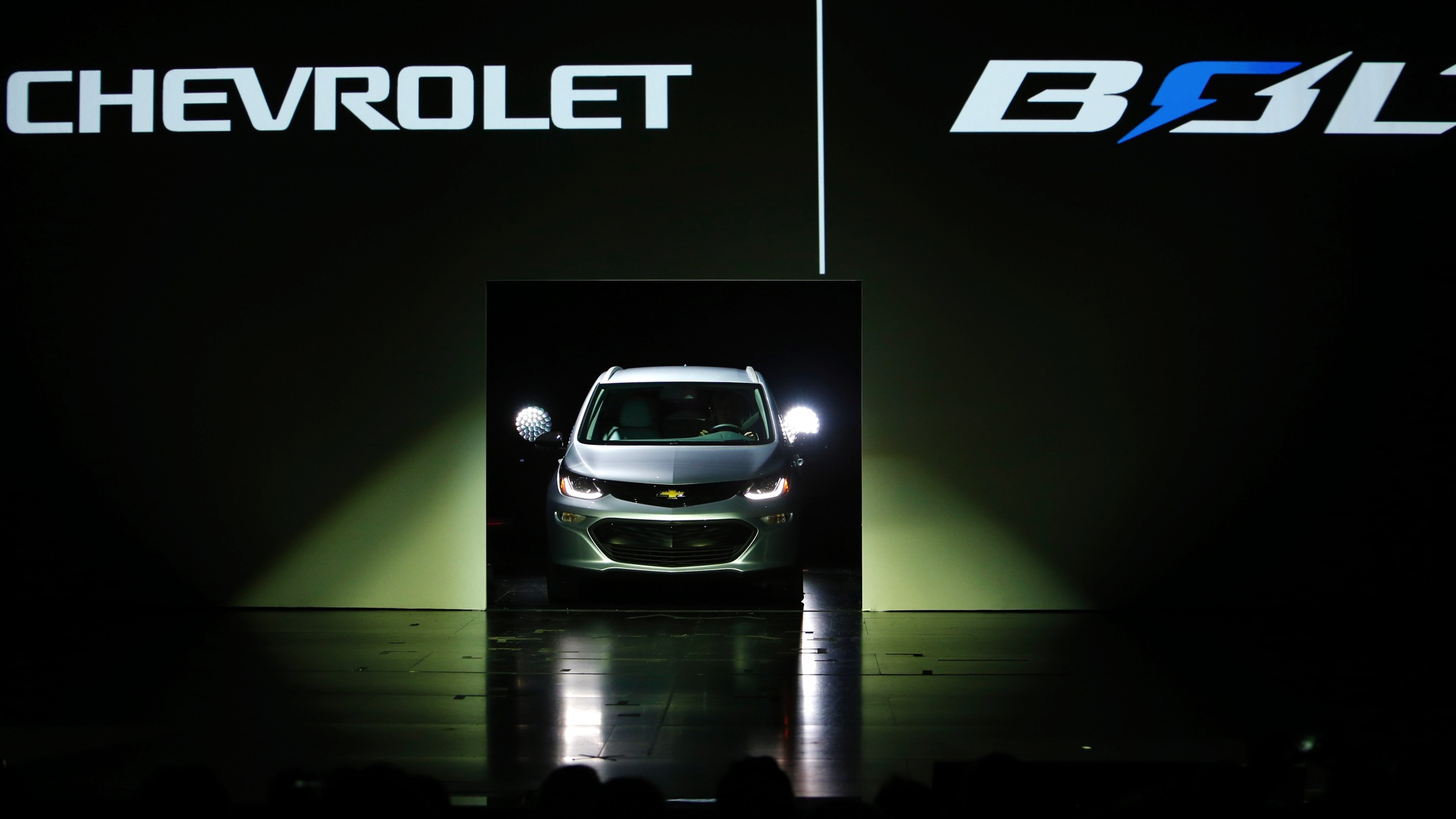 The 2017 Chevrolet Bolt EV is driven onto the stage during a General Motors keynote address at the 2016 CES trade show in Las Vegas, Nevada January 6, 2016. The car will have a 200-mile range and cost about $30,000, said GM Chairman and CEO Mary Barra. REUTERS/Steve Marcus - RTX21BNY