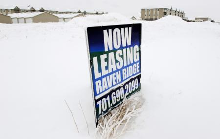 A sign advertises apartments for rent in Dickinson, North Dakota January 21, 2016. Low oil prices have forced rents down across North Dakota's Bakken oil field, as many workers have lost their jobs or left the industry. The collapse of U.S. oil and gas investment could have further to fall and Americans are showing signs they spend less of their windfall from lower gasoline prices than in the past, darkening the outlook for the U.S. economy.