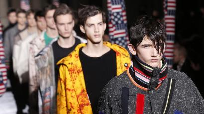 Models present creations by Raf Simons/Sterling Ruby during the Fall/Winter 2014-2015 men's fashion show in Paris on January, 15, 2014.